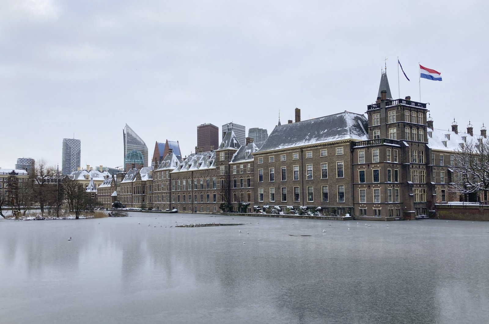 The frozen Hofvijver pond is seen outside the Dutch parliament buildings in The Hague, Netherlands, Tuesday, Feb. 9, 2021. (AP Photo)