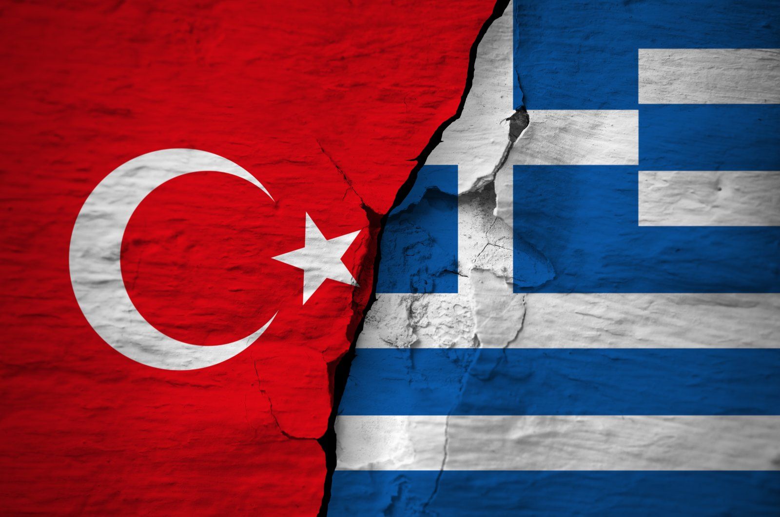 In this illustration, the flags of Turkey and Greece are seen on a cracked concrete wall. (Photo by Shutterstock)
