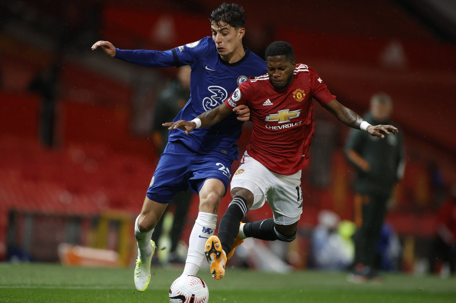 Chelsea's Kai Havertz (L) duels for the ball with Manchester United's Fred during a Premier League match at the Old Trafford stadium in Manchester, England, Oct. 24, 2020. (AP Photo)