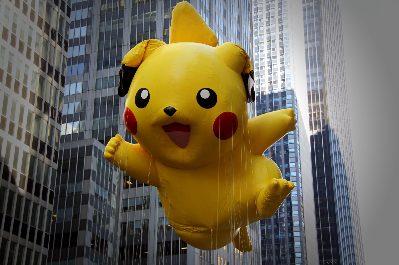 A Pokemon Pikachu balloon can be seen at the 86th annual Macy's Thanksgiving Day parade in New York, U.S., Nov. 22, 2012. (Shutterstock Photo)