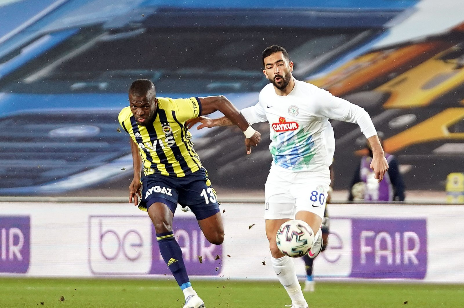 "Fenerbahçe's Enner Valencia in action against Rizespor's Yassine Meriah, against the backdrop of a sign reading ""Be Fair"" in protest of broadcaster bein Sports, in Istanbul, Turkey, Jan. 30, 2021. (İHA Photo)"
