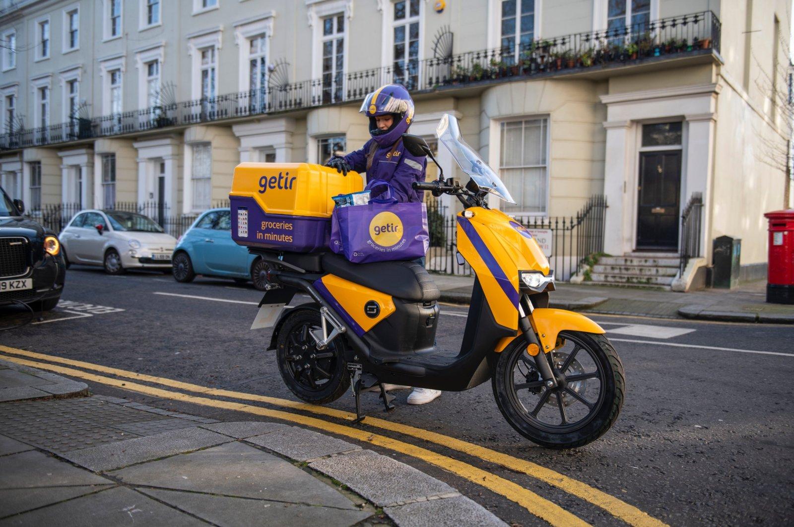 A Getir courier is seen beside his bike, London, U.K., Jan. 27, 2021. (Courtesy of Getir)