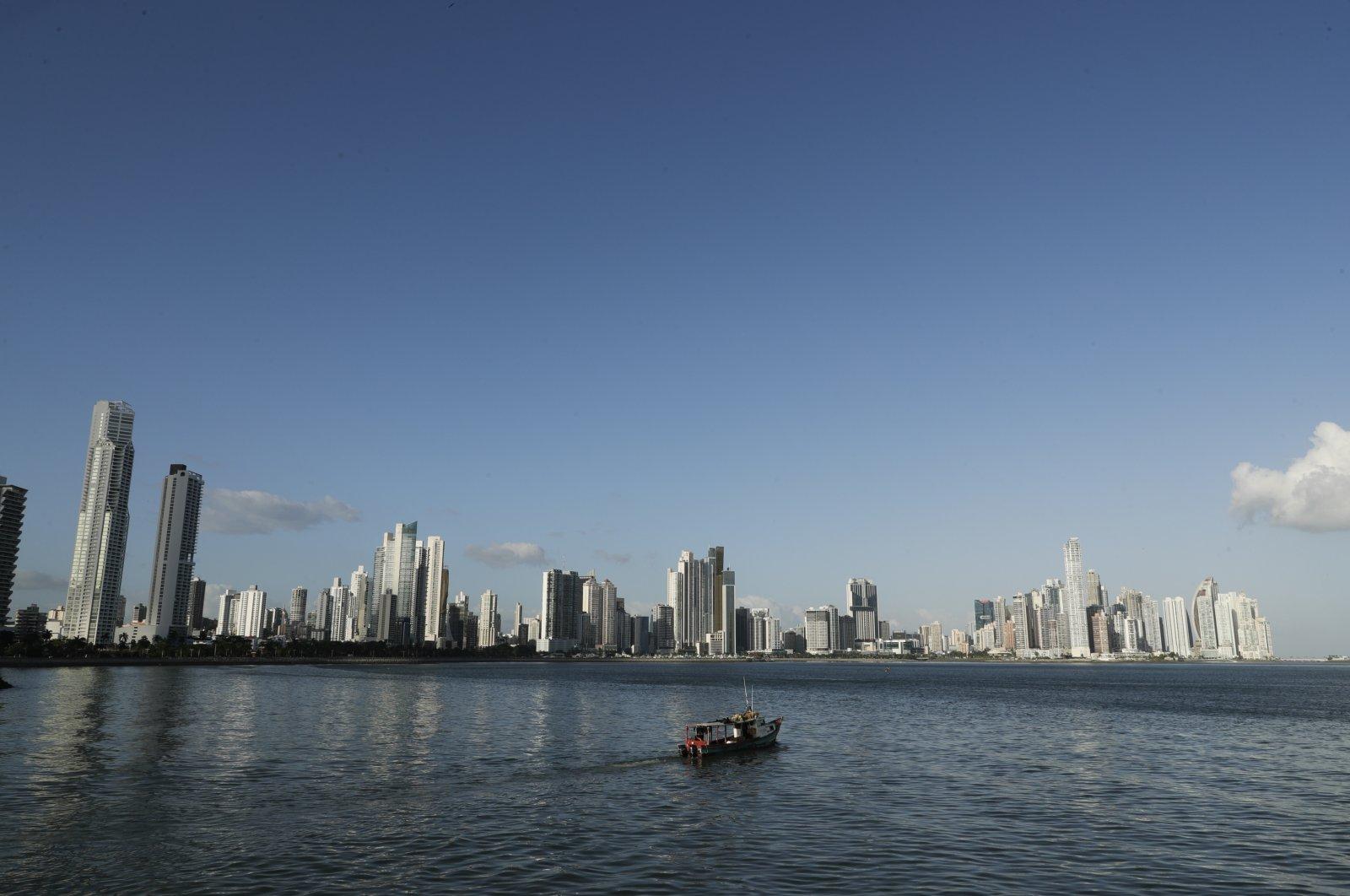 A fishing boat sails in Panama Bay, in Panama City, Panama, Jan. 19, 2021. (AP Photo)