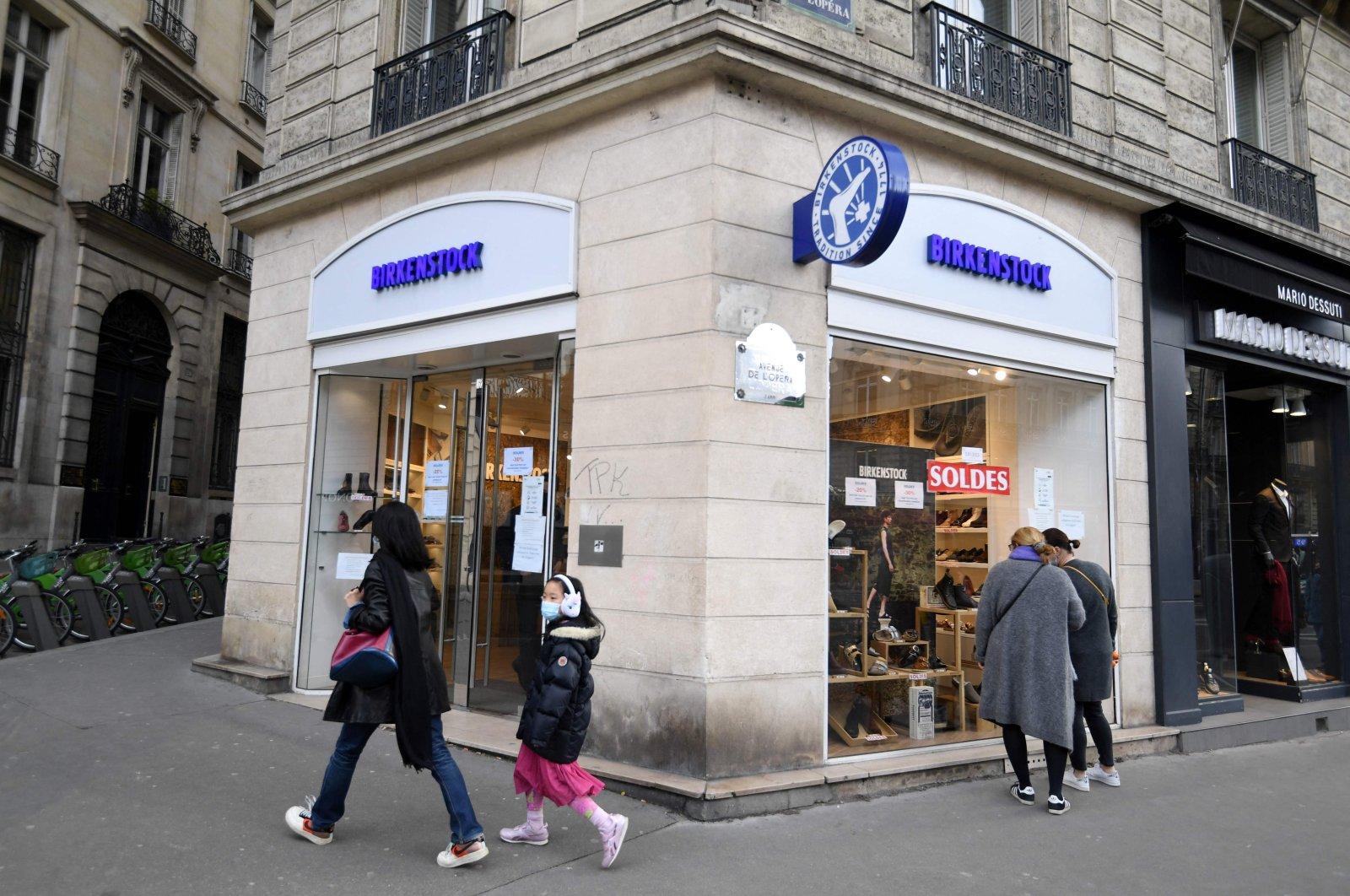 Pedestrians walk past a Birkenstock outlet in Paris, France, Feb. 26, 2021. (AFP Photo)