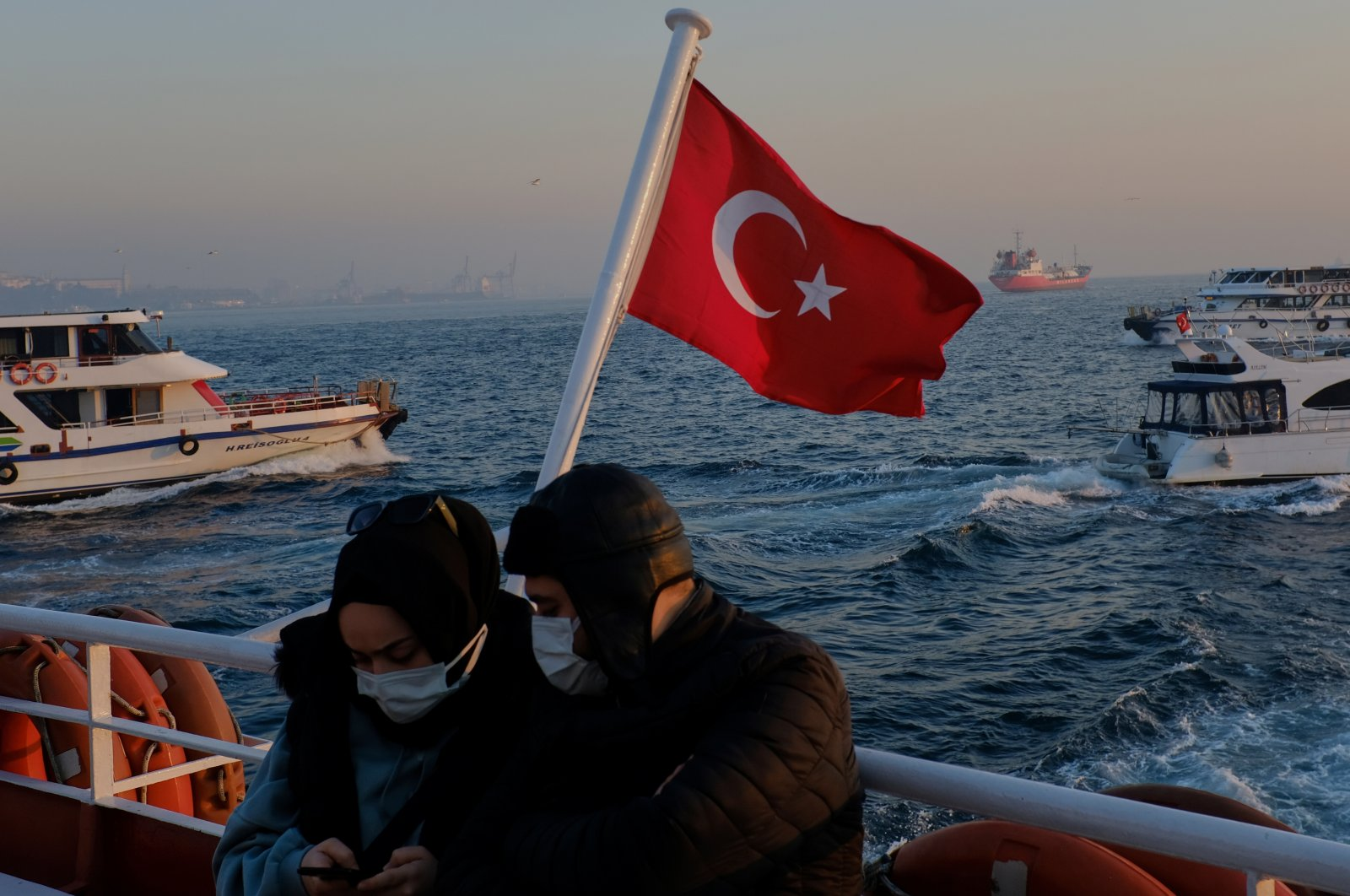 A couple wearing protective masks travel on a ferry over the Bosphorus, amid the coronavirus disease (COVID-19) outbreak in Istanbul, Turkey, Feb. 23, 2021. (Reuters Photo)