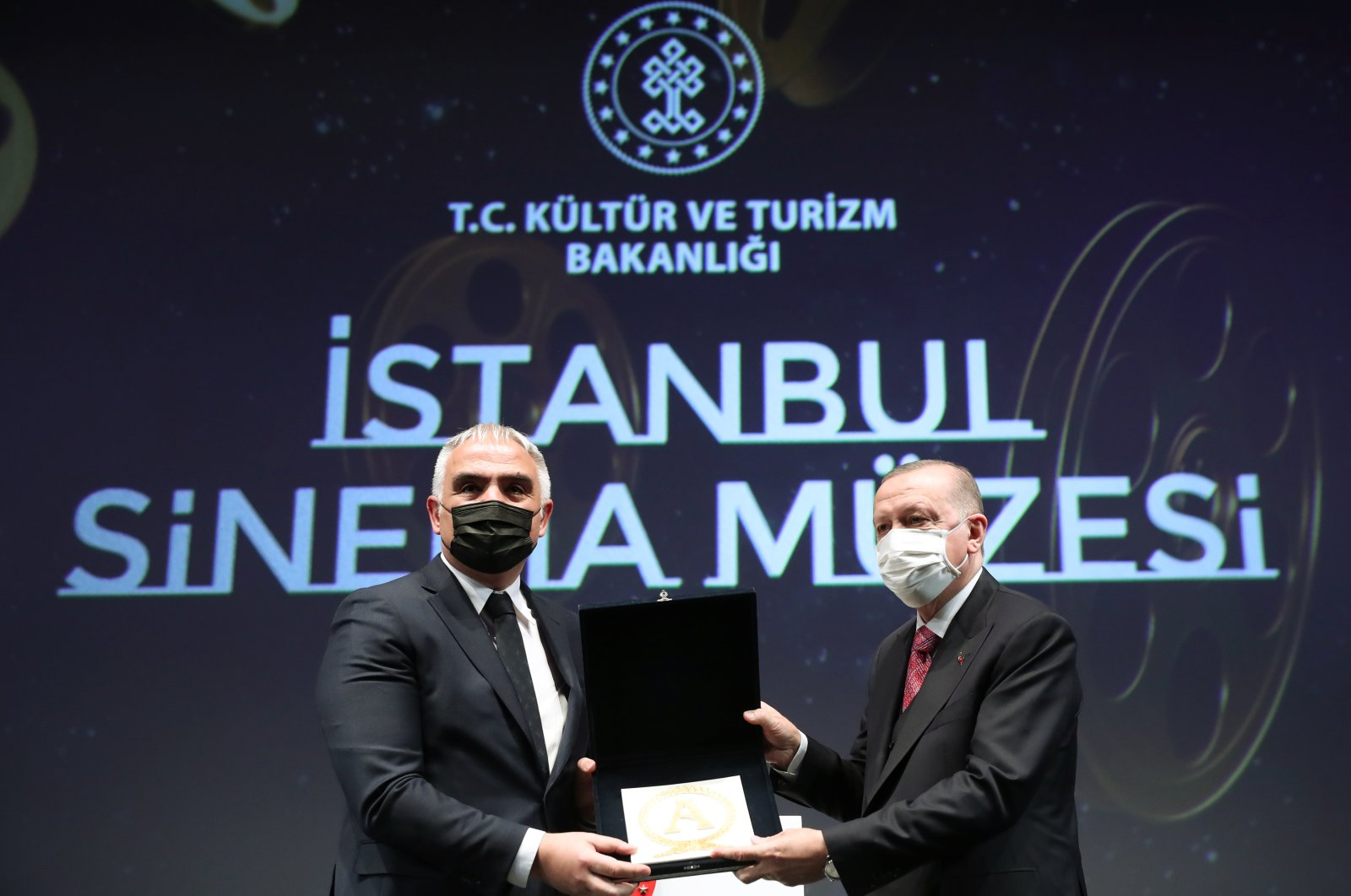 Culture and Tourism Minister Mehmet Nuri Ersoy (L) along with President Recep Tayyip Erdoğan during the opening of the Atlas Theatre and İstanbul Cinema Museum, Istanbul, Turkey, Feb. 26, 2021. (AA Photo)