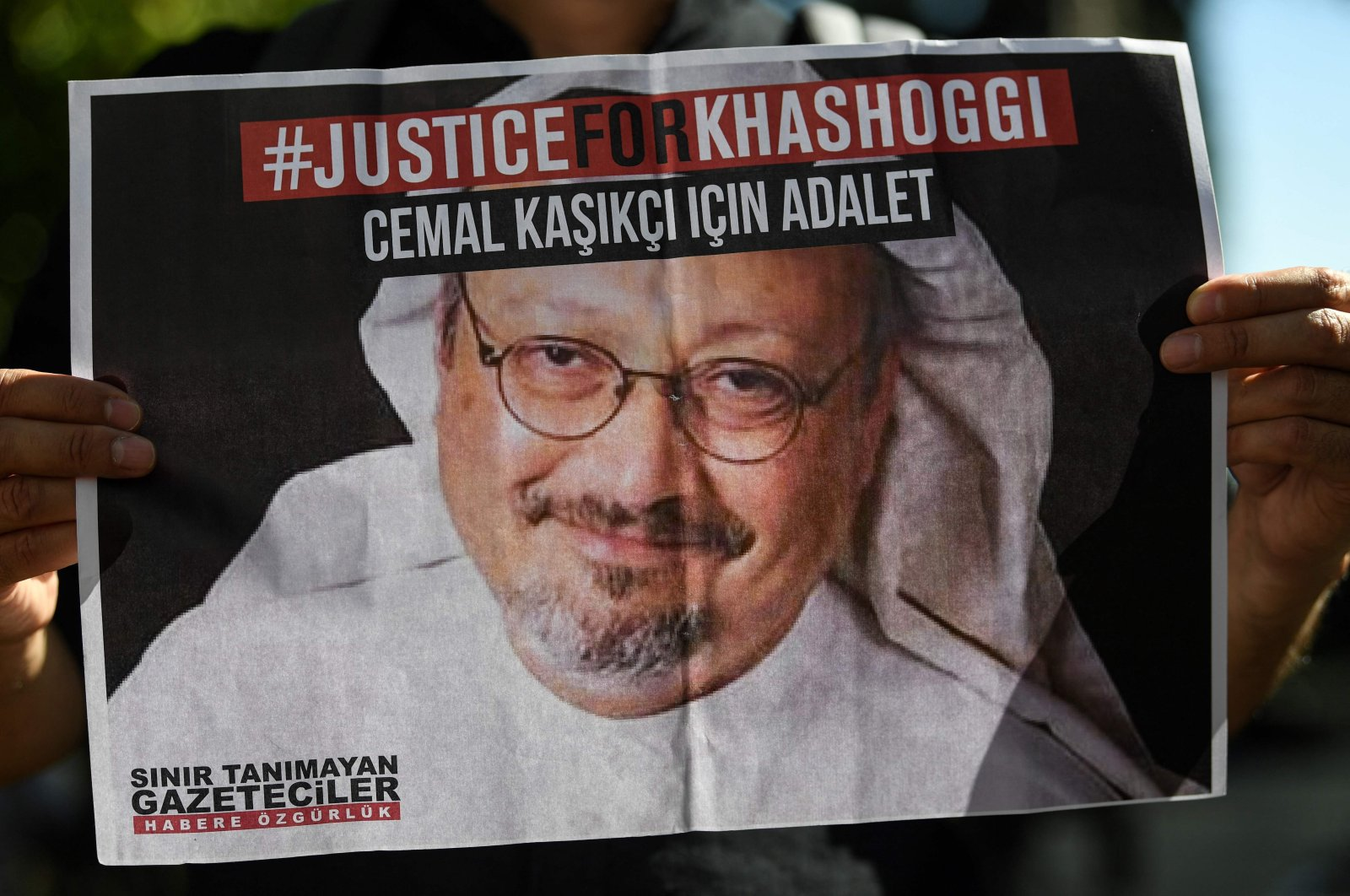 Friends of murdered Saudi journalist Jamal Khashoggi hold posters bearing his picture as they attend an event marking the second-year anniversary of his assassination in front of Saudi Arabia's Istanbul Consulate, Istanbul, Turkey, Oct. 2, 2020. (AFP Photo)