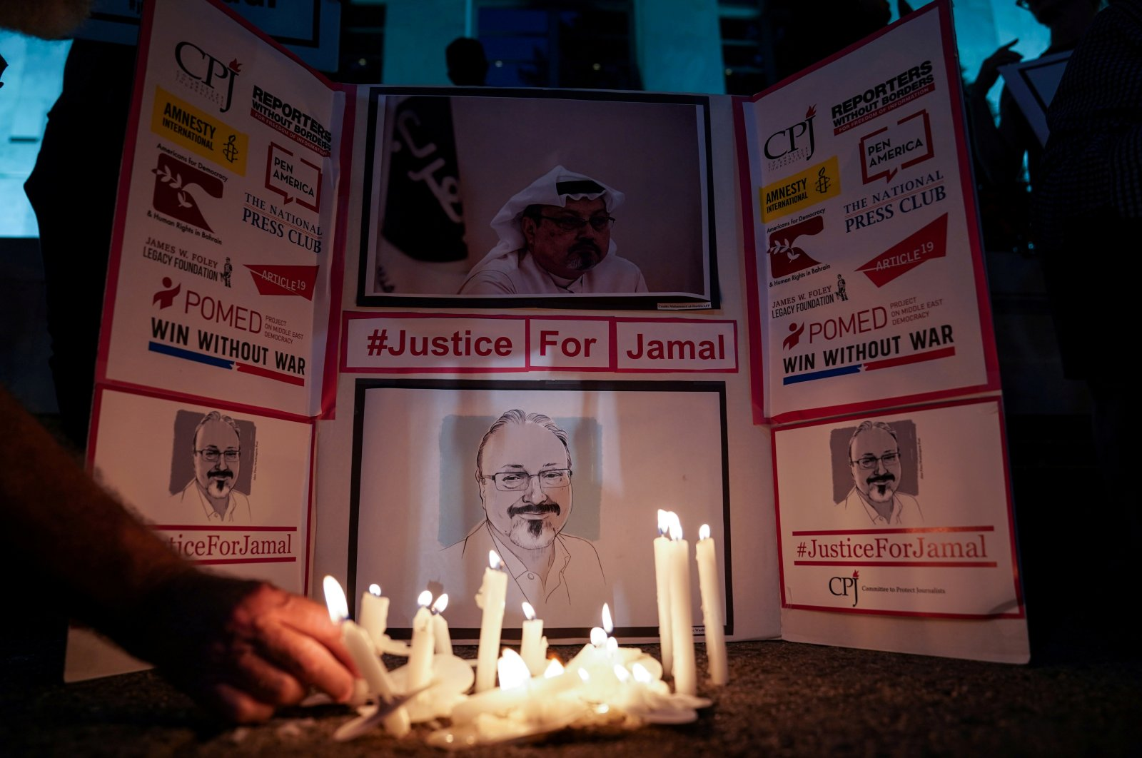 The Committee to Protect Journalists and other press freedom activists hold a candlelight vigil in front of the Saudi Embassy to mark the anniversary of the killing of journalist Jamal Khashoggi at the kingdom's consulate in Istanbul, Washington, D.C, the U.S., Oct. 2, 2019. (Reuters Photo)