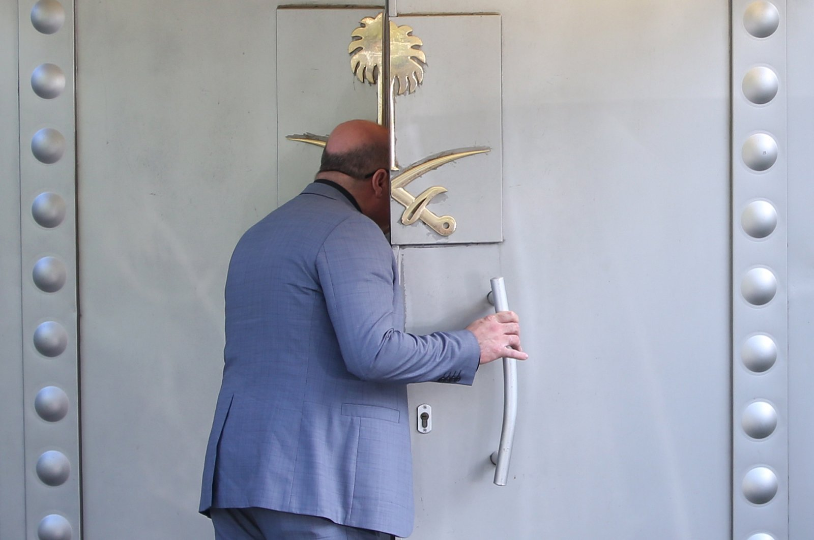 A Saudi official opens the door in the Saudi consulate in Istanbul, Turkey, Oct. 7, 2018. (EPA Photo)