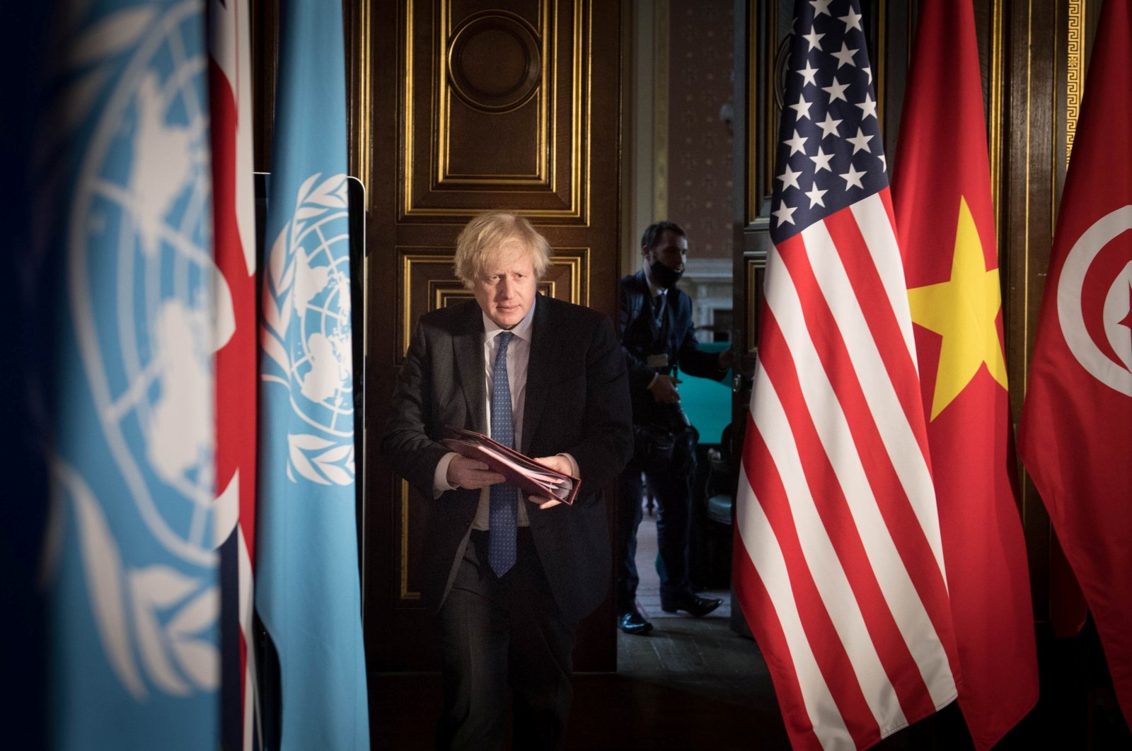 Britain's Prime Minister Boris Johnson chairs a session of the United Nations Security Council on climate and security at the Foreign, Commonwealth and Development Office in London, Britain, Feb. 23, 2021. (Stefan Rousseau/PA Wire/Pool via REUTERS)