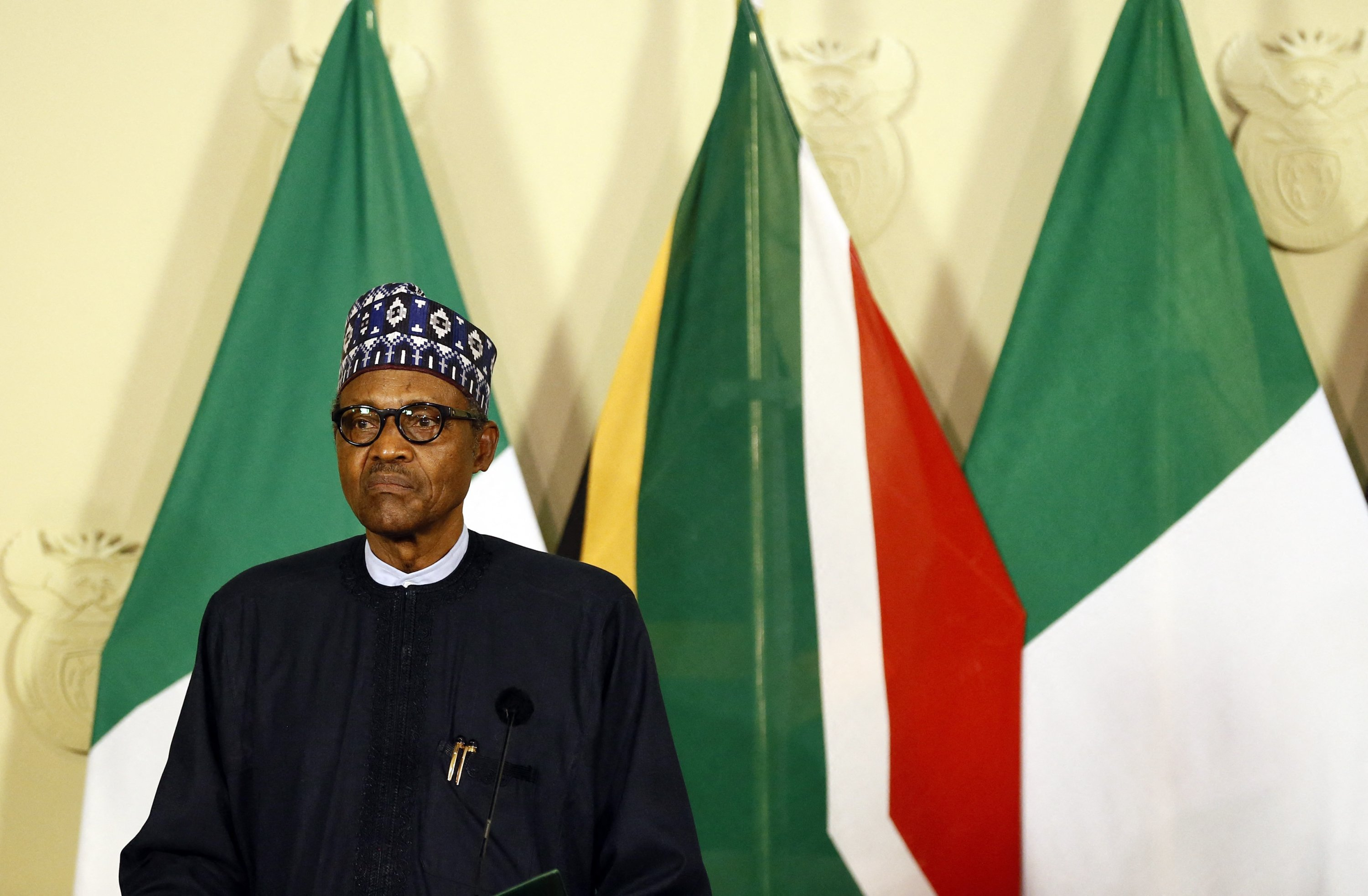 Nigeria's President Muhammadu Buhari looks on while giving a press conference during his official state visit at Union Buildings in Pretoria, South Africa, Oct. 03, 2019. (Photo by Phill Magakoe / AFP)