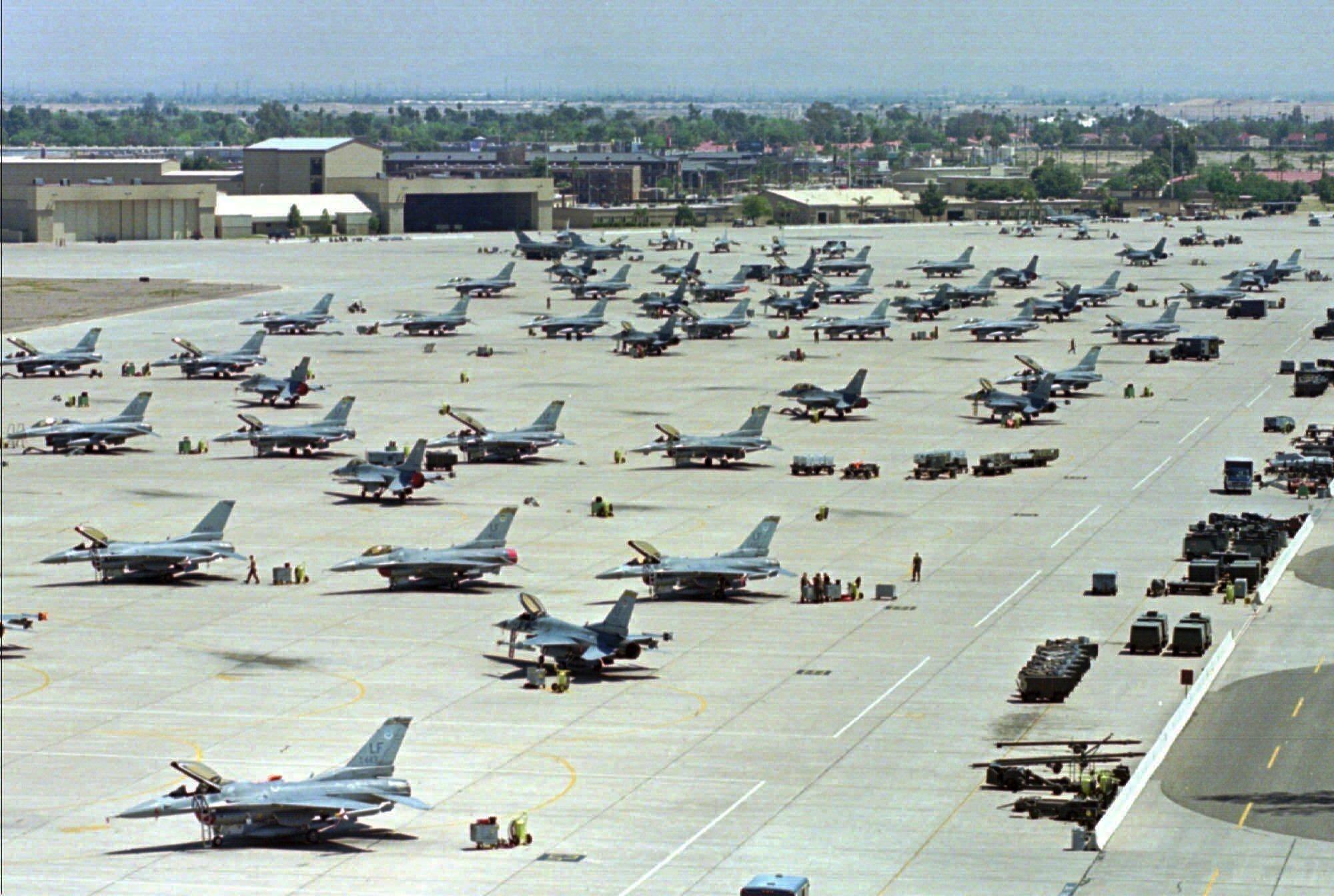 F-16 Fighting Falcons sit on the tarmac at Luke Air Force Base in Glendale, Arizona, April 14, 1999. (AP Photo/Ken Levine, File)