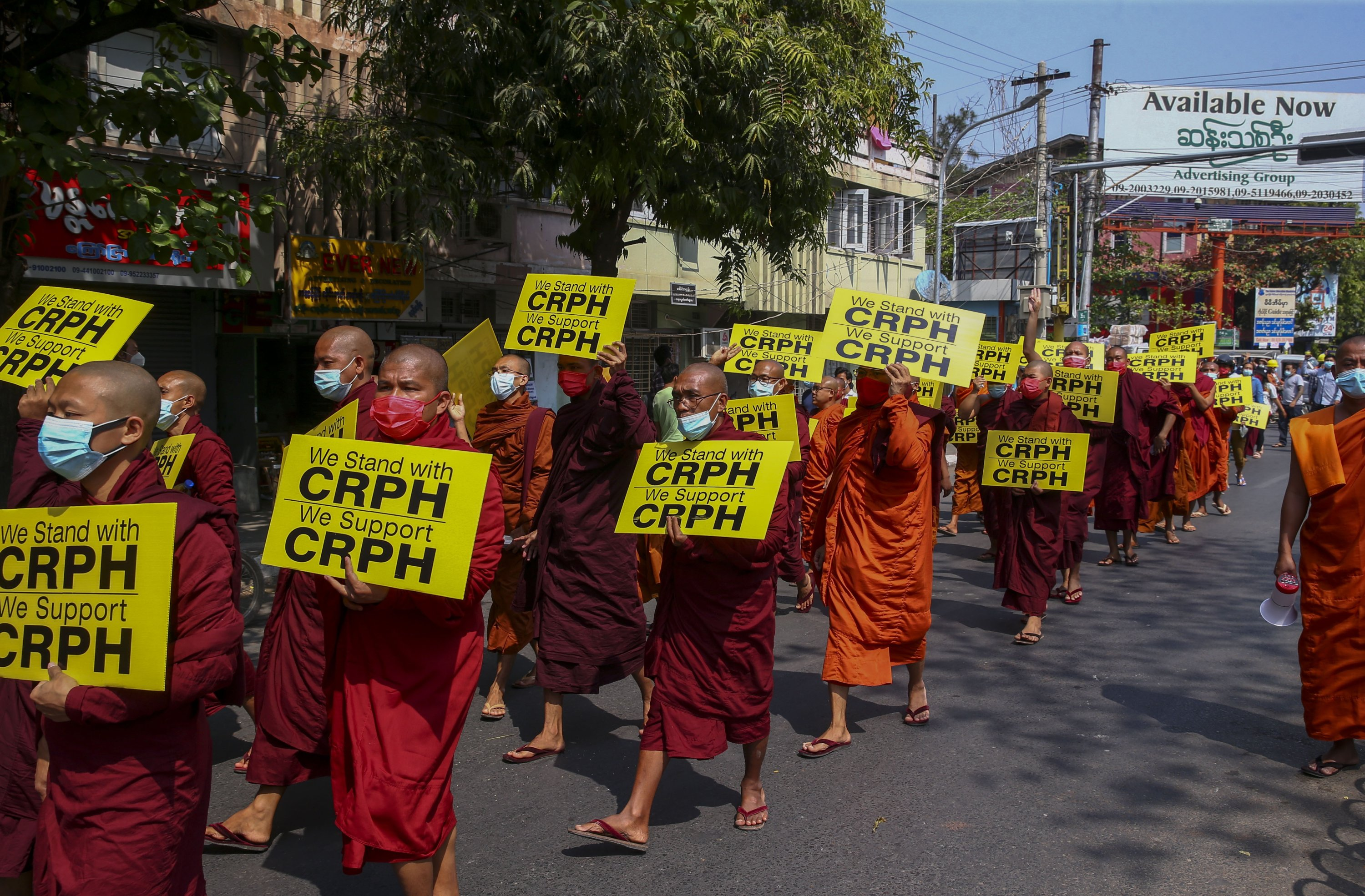 Buddhist monks lead an anti-coup protest march holding placards that read CRPH, which stands for Committee Representing Pyidaungsu Hluttaw, Mandalay, Myanmar, Feb. 27, 2021. (AP Photo)