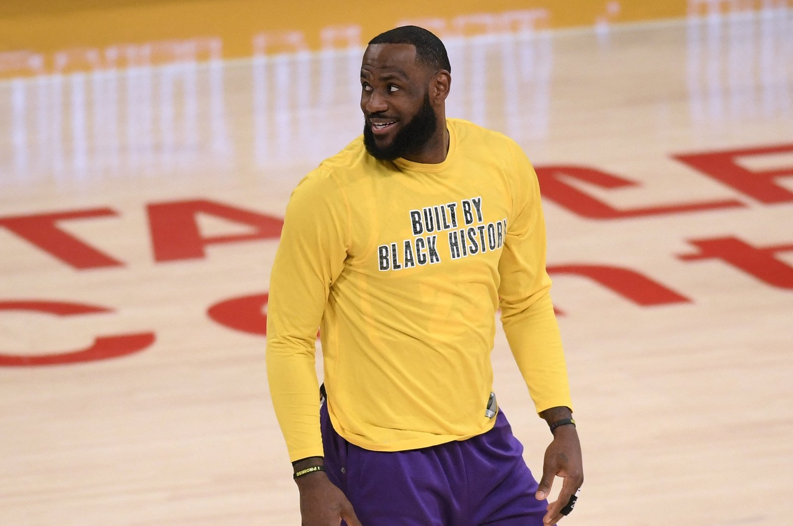 LeBron James of the Los Angeles Lakers smiles as he warms up before an NBA basketball game against the Portland Trail Blazers, in Los Angeles, California, Feb. 26, 2021. (AFP Photo)