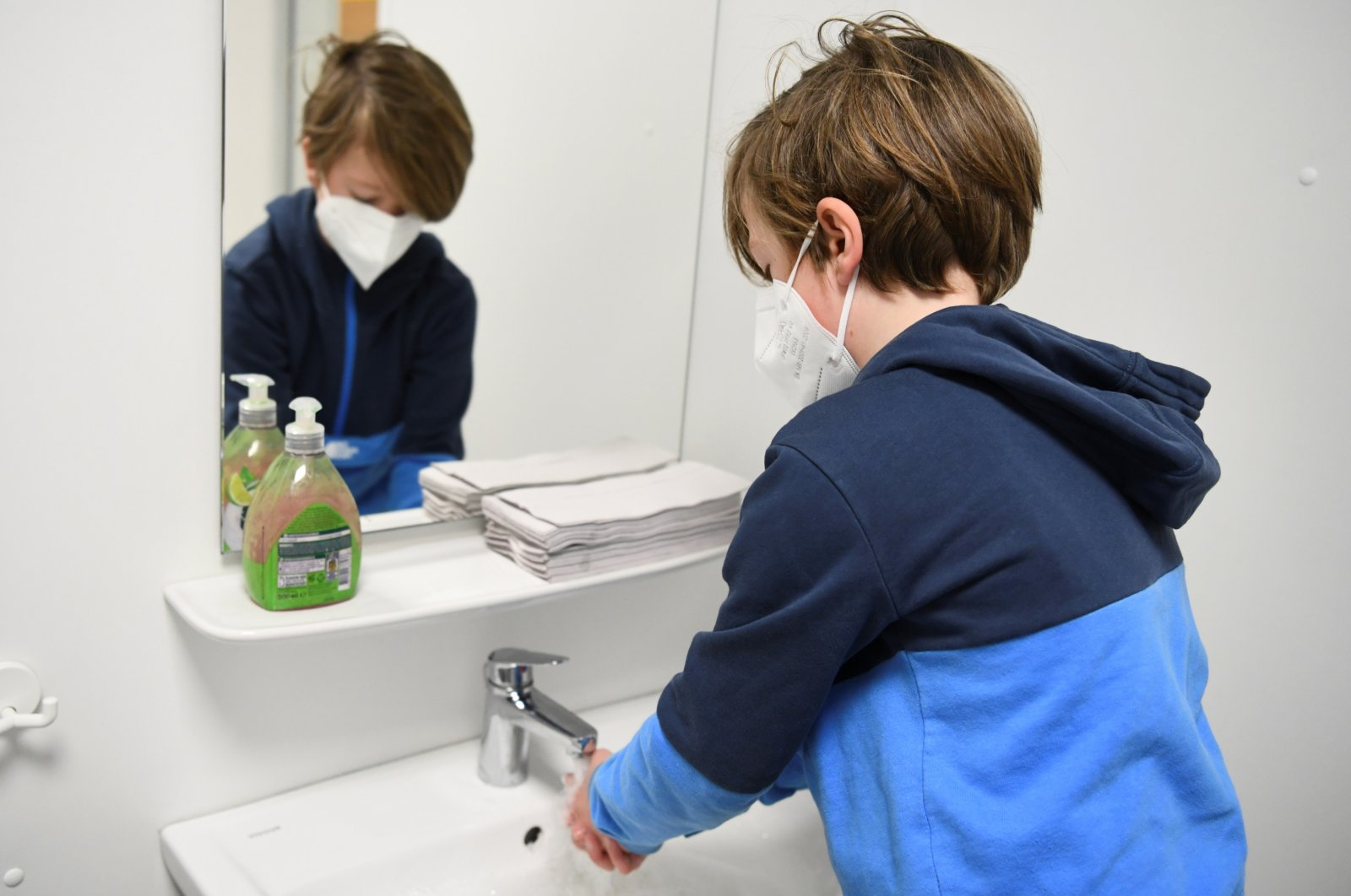 A schoolchild washes his hands before participating in a lesson at Gustav-Falke elementary school after it reopened according to first measures to lift the coronavirus disease (COVID-19) lockdown in Berlin, Germany, Feb. 22, 2021. (Reuters Photo)