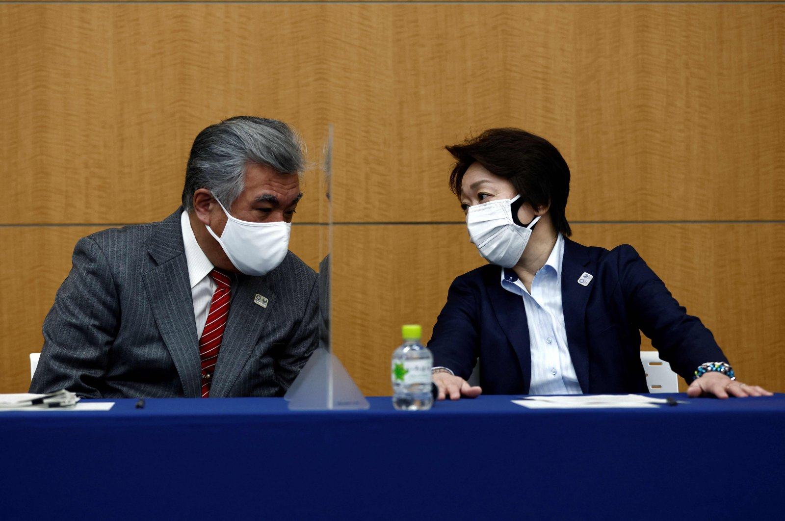 Tokyo 2020 Vice Director-General Yukihiko Nunomura (L) speaks with President of the Tokyo 2020 Olympics Organising Committee Seiko Hashimoto before the press briefing on operations and media coverage of the Tokyo 2020 Olympic Torch Relay in Tokyo, Japan, on Feb. 25, 2021. (AFP Photo)