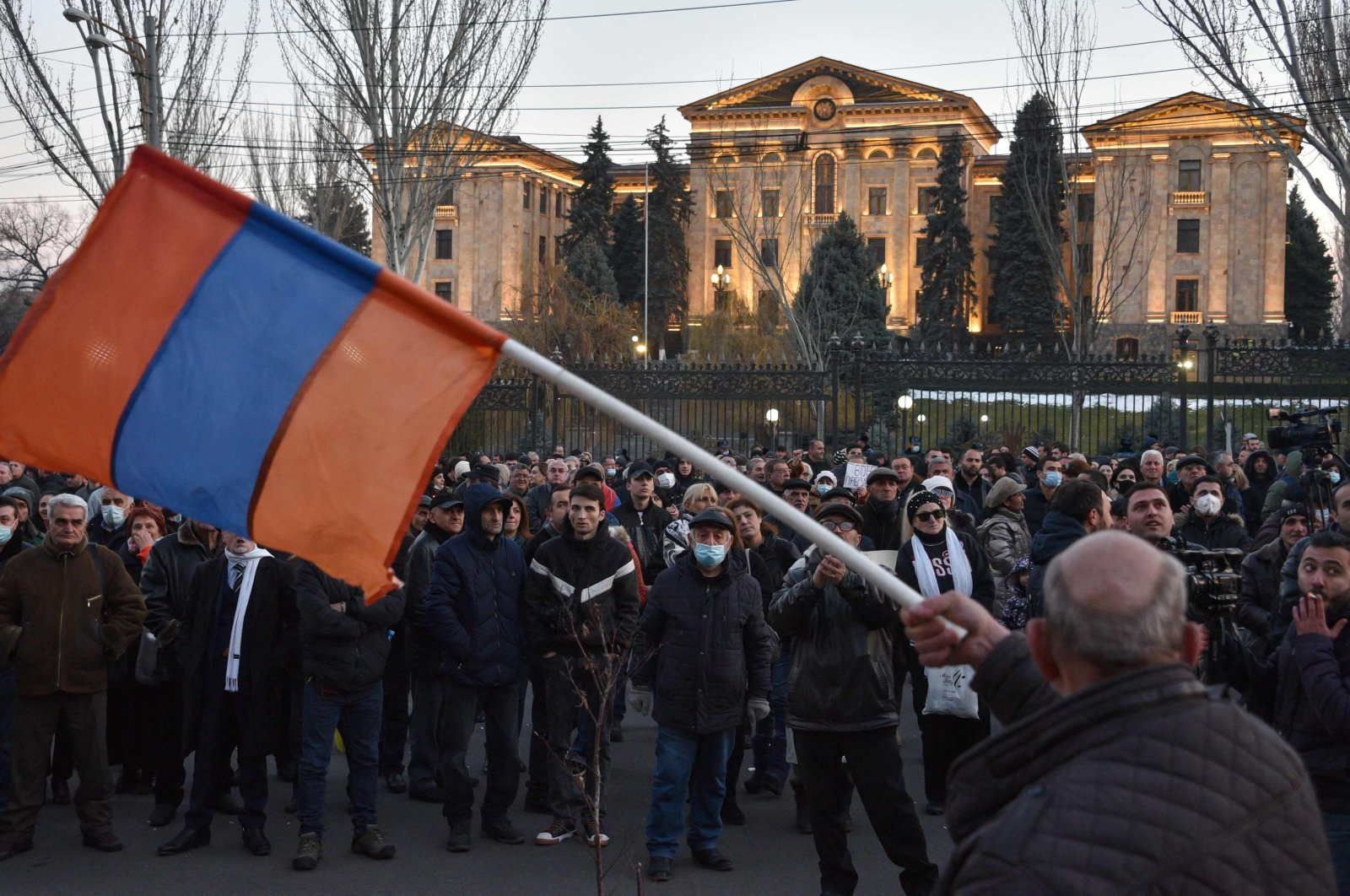 Opposition supporters rally outside the National Assembly building to demand Prime Minister Nikol Pashinian's resignation over his handling of last year's war with Azerbaijan, in Yerevan on Feb. 26, 2021. (AFP Photo)
