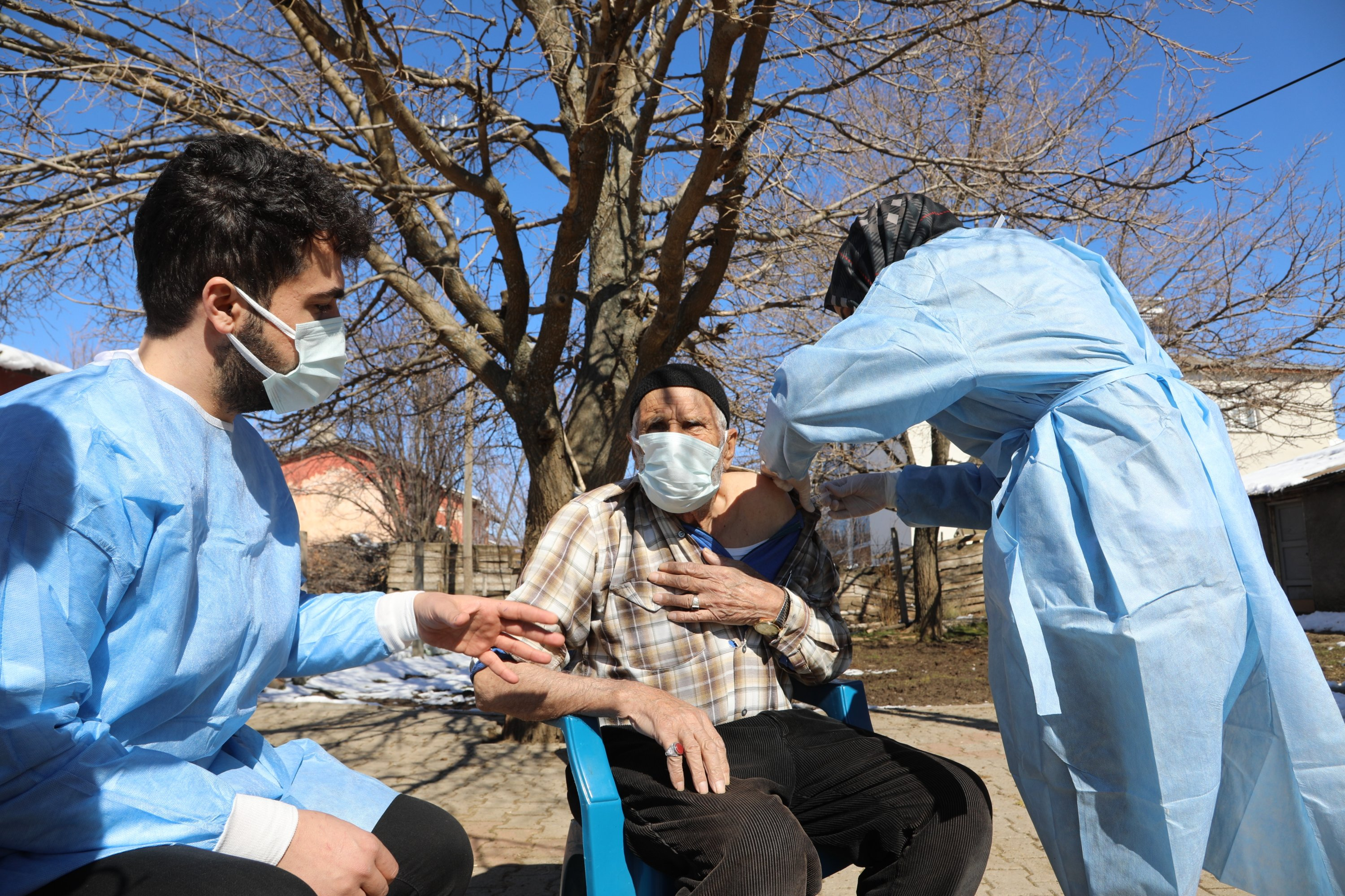 Health care workers inoculate an elderly man in a village, in Bingöl, eastern Turkey, Feb. 28, 2021. (AA PHOTO)