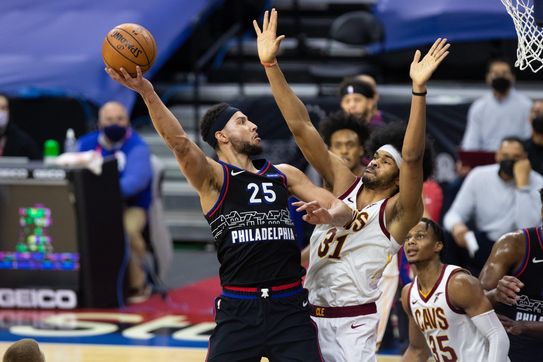 Philadelphia 76ers guard Ben Simmons (L) shoots a hook shot past Cleveland Cavaliers center Jarrett Allen (R) during an NBA match at Wells Fargo Center, Philadelphia, Pennsylvania, Feb 27, 2021.