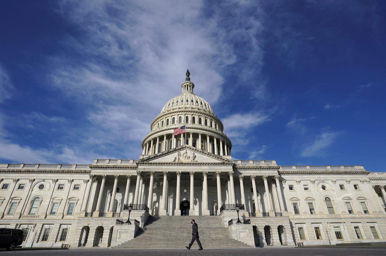 A man makes his way past the U.S. Capitol in Washington, U.S., Feb. 26, 2021. (Reuters Photo)