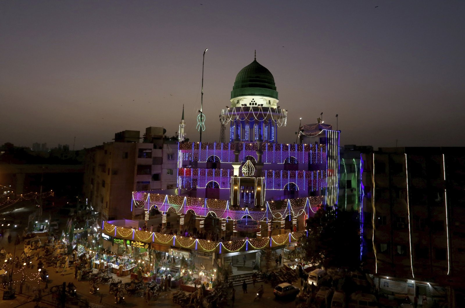 A mosque is decorated with lights for the Mawlid an-Nabi holiday celebrating the birthday of the Prophet Muhammad, in Karachi, Pakistan, Oct. 25, 2020. (AP Photo)