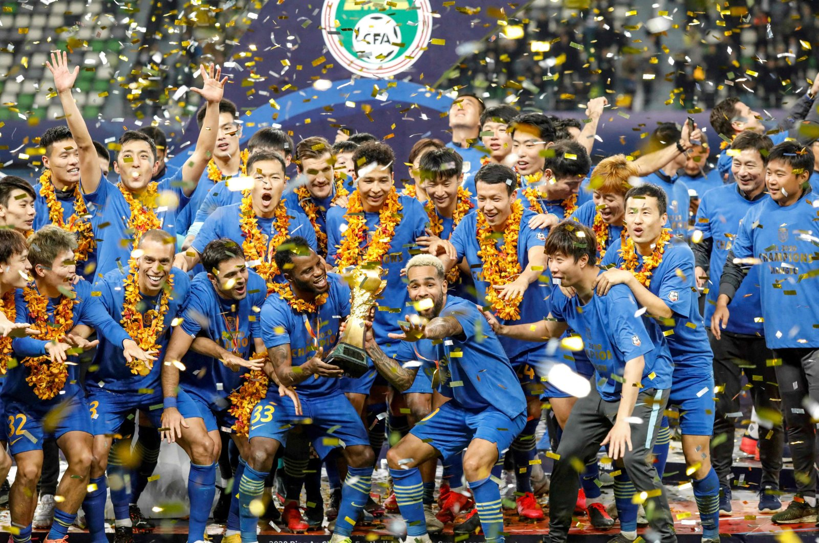 Jiangsu Suning players and staff members celebrating after winning the Chinese Super League (CSL) football championship in Suzhou, eastern China, Nov. 12, 2020. (AFP Photo)