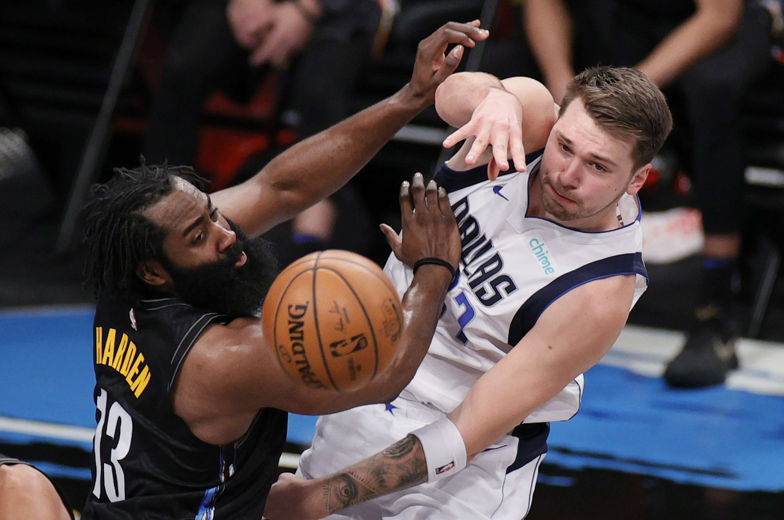 Dallas Mavericks' Luka Doncic (R) passes the ball as Brooklyn Nets'James Harden (L) defends during an NBA match at Barclays Center, New York, Feb. 27, 2021. (AFP Photo)
