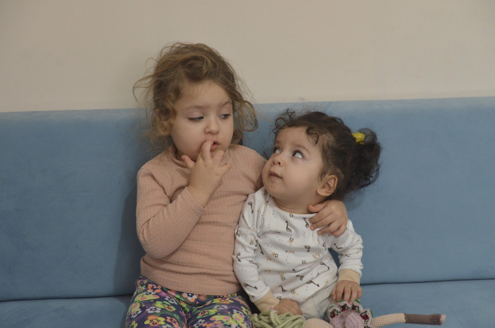 Zehra Elmalıca (L) sits next to her two-year-old sister Öykü, a spinal muscular atrophy (SMA) patient, in the capital Ankara, Turkey, Dec. 11, 2020. (DHA PHOTO)