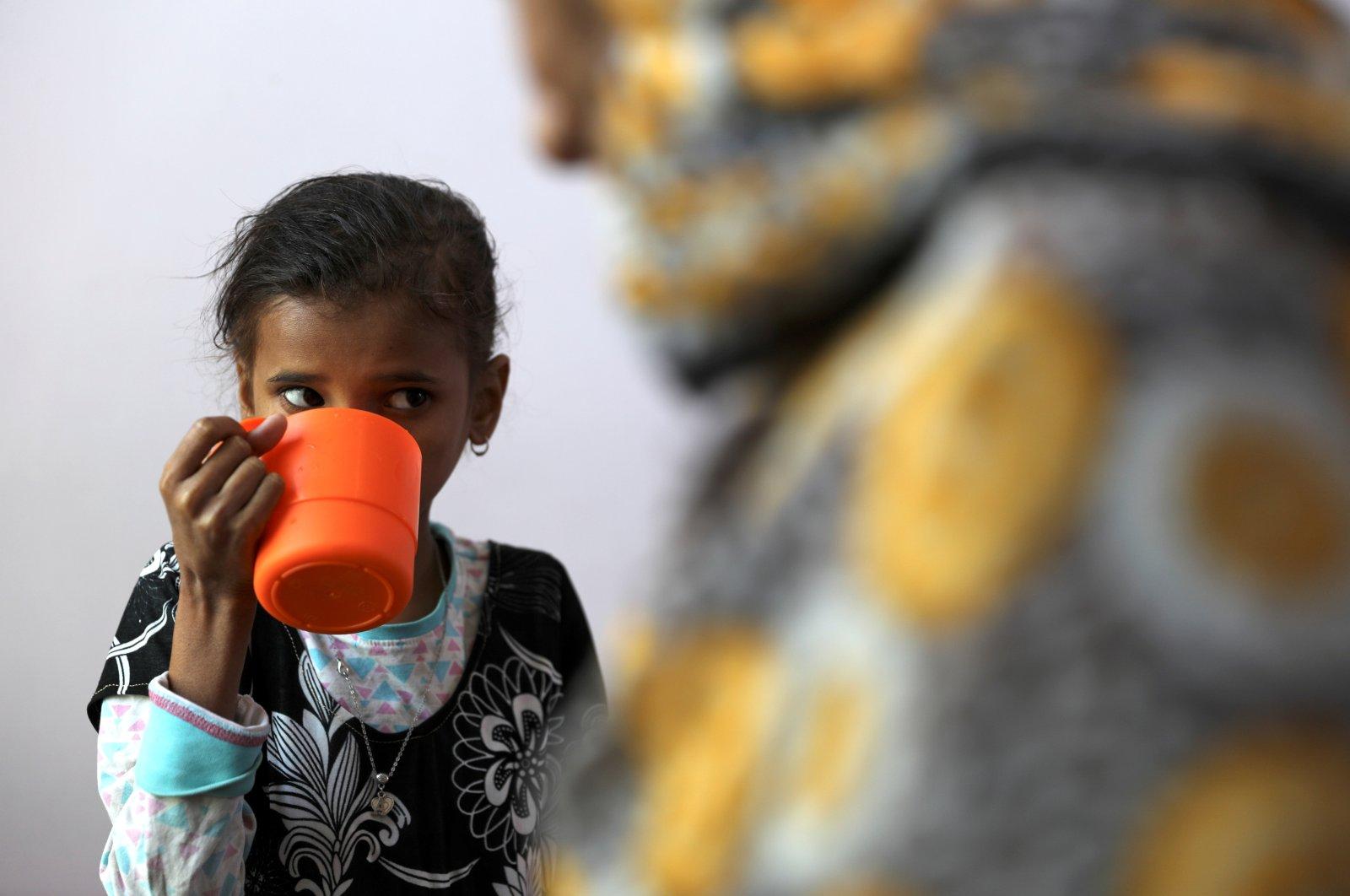 Ahmadiya Juaidi, 13, drinks a supplemental nutrition shake at a malnutrition treatment ward of al-Sabeen hospital in Sanaa, Yemen, Feb. 24, 2021. (Reuters Photo)