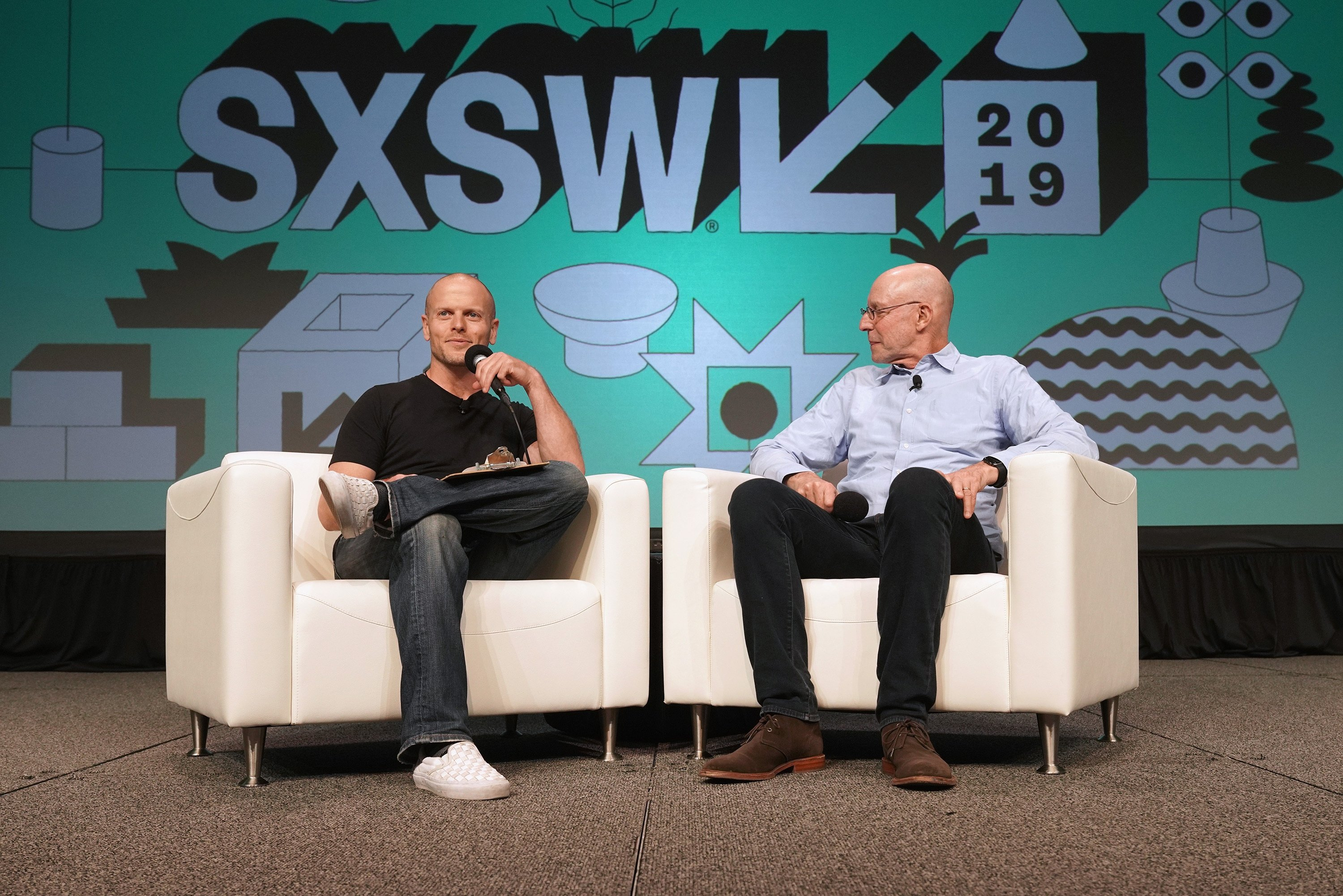 Tim Ferriss (L) and Michael Pollan speak onstage at Featured Session: Michael Pollan and Tim Ferriss during the 2019 SXSW Conference and Festivals at Austin Convention Center on March 10, 2019 in Austin, Texas.  (Getty Images for SXSW)