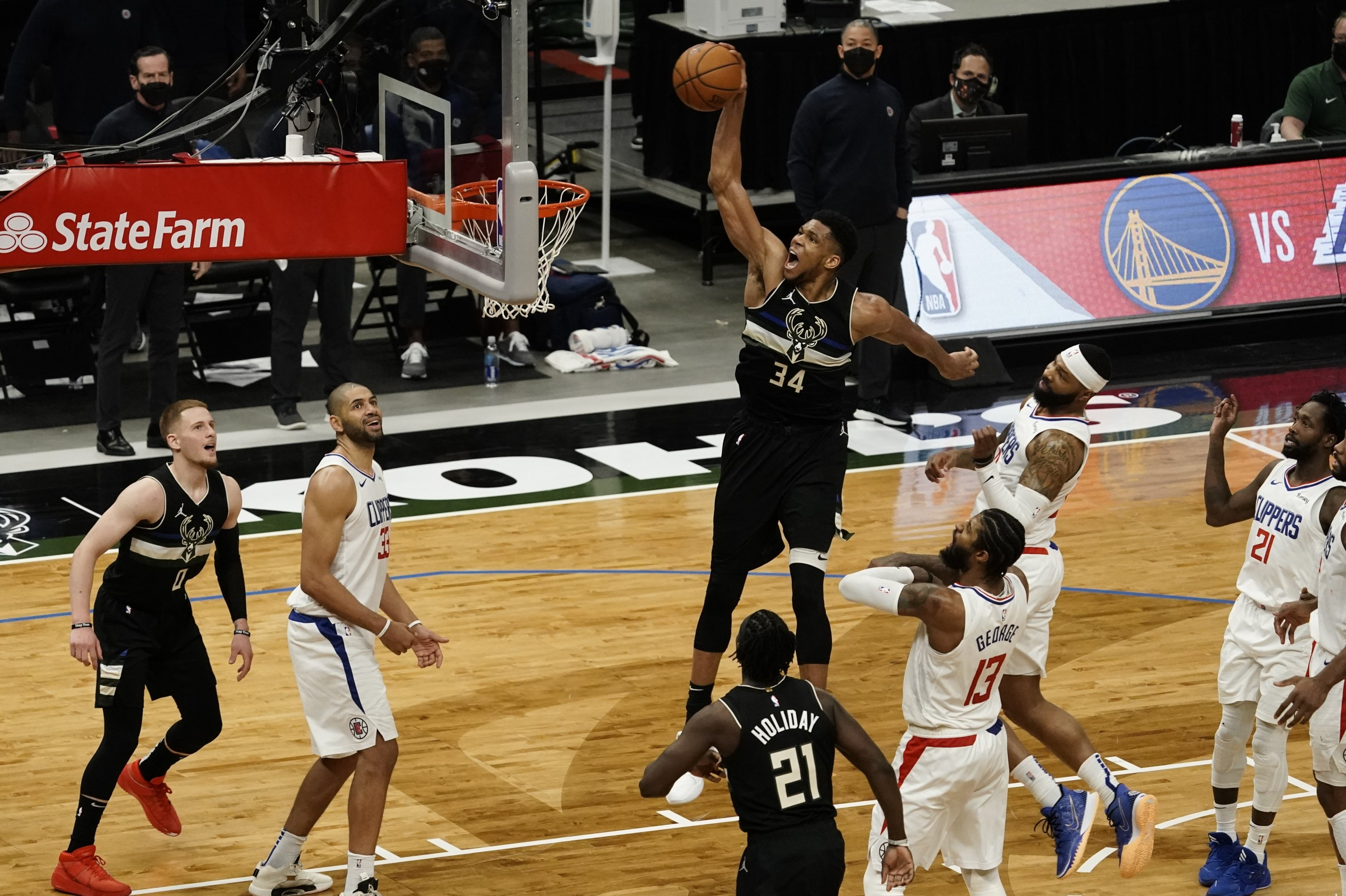 Milwaukee Bucks' Giannis Antetokounmpo (C) dunks during the second half of an NBA basketball game against the LA Clippers, in Milwaukee, Wisconsin, Feb. 28, 2021. (AP Photo)