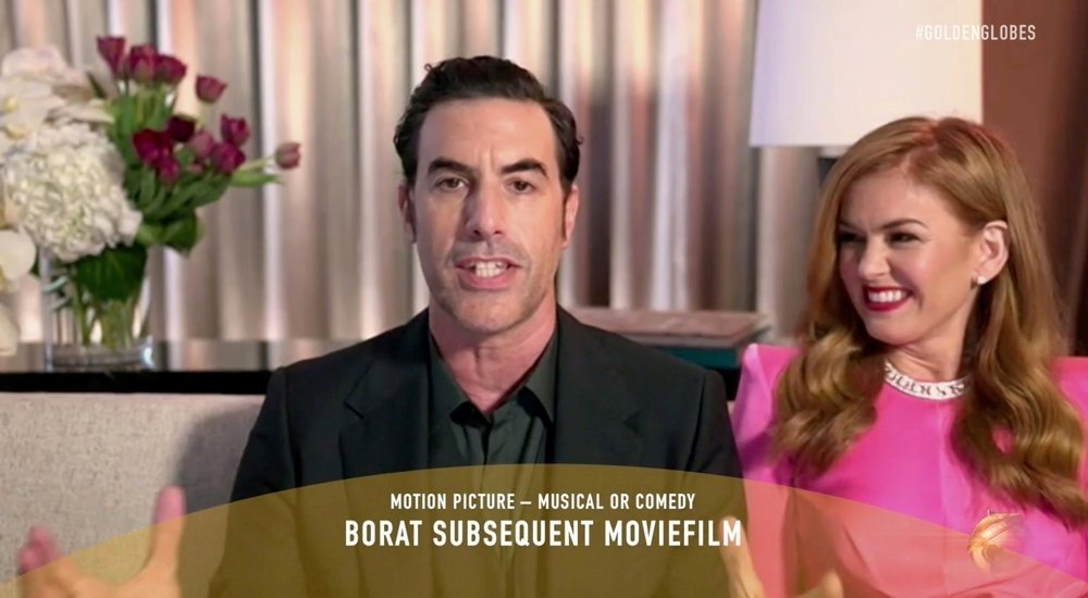 Sacha Baron Cohen, with Isla Fisher, accepts the Best Picture - Musical/Comedy award for 'Borat Subsequent Moviefilm' via video in this handout screengrab from the 78th Annual Golden Globe Awards in Beverly Hills, California, U.S., February 28, 2021. (REUTERS Photo)
