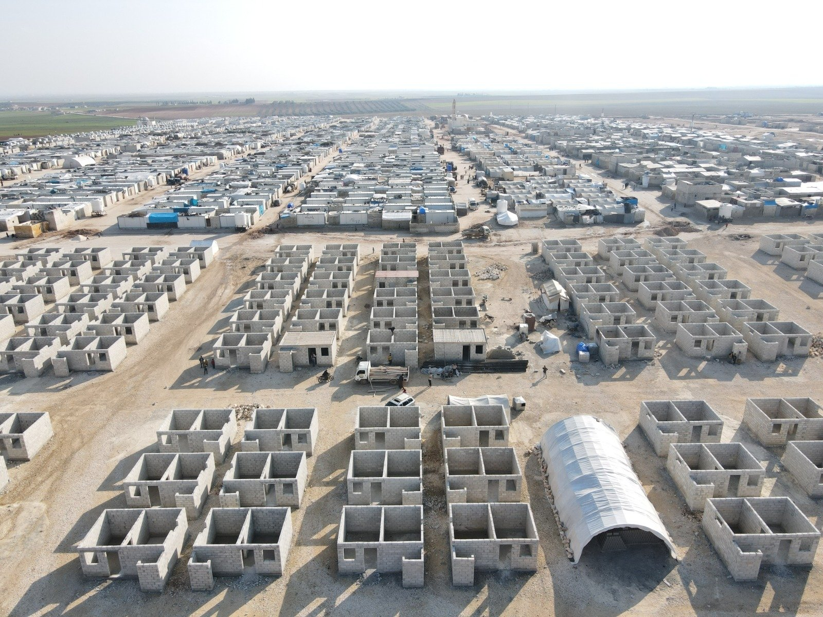 Three-hundred briquette houses in the new town are expected to be completed by the end of this month in northern Syria's Azaz, March 1, 2021. (AA Photo)