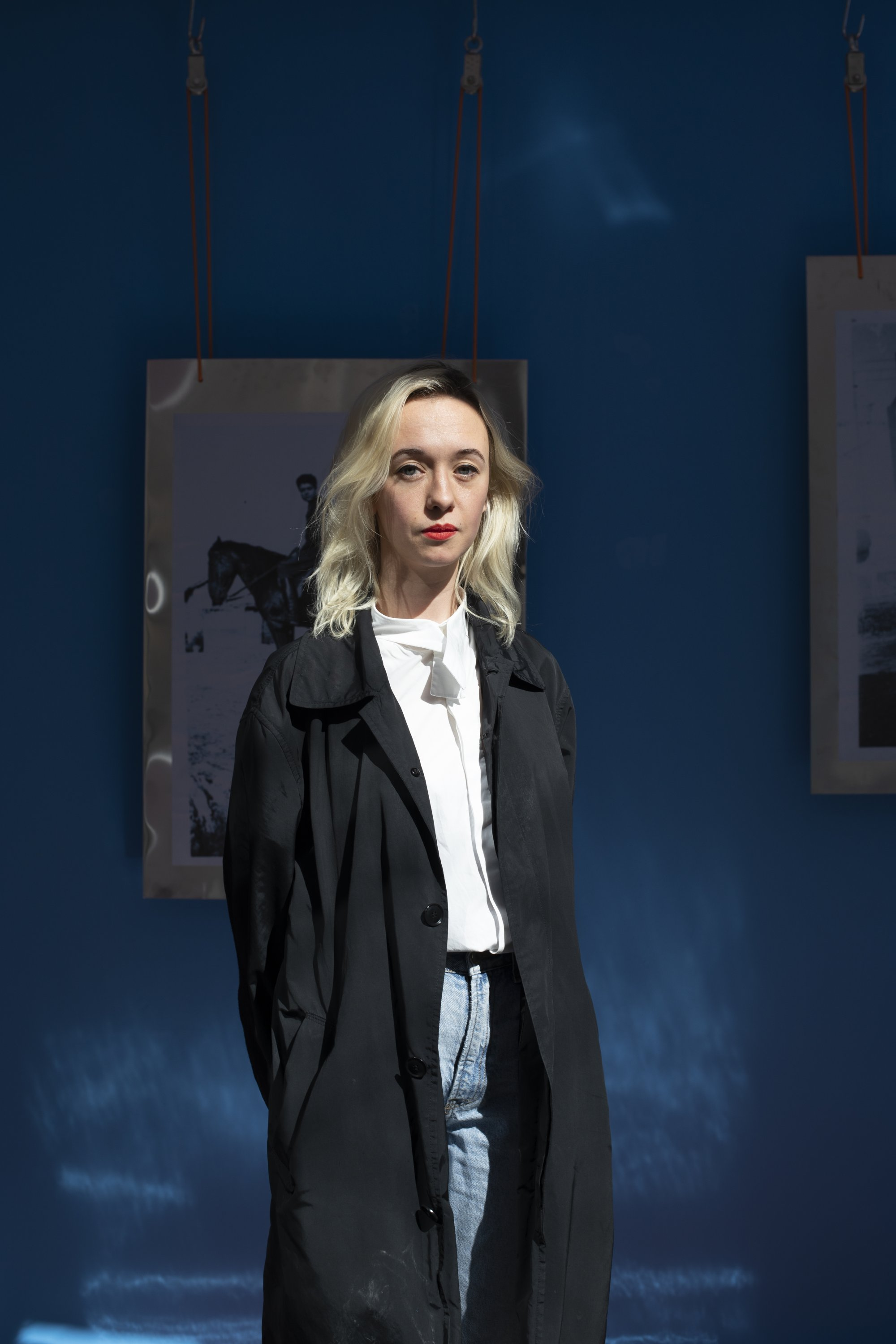 """Artist Eline Tsvetkova poses in front of an old photo from """"Blue Kısmet."""" (Courtesy of Viable Istanbul)"""