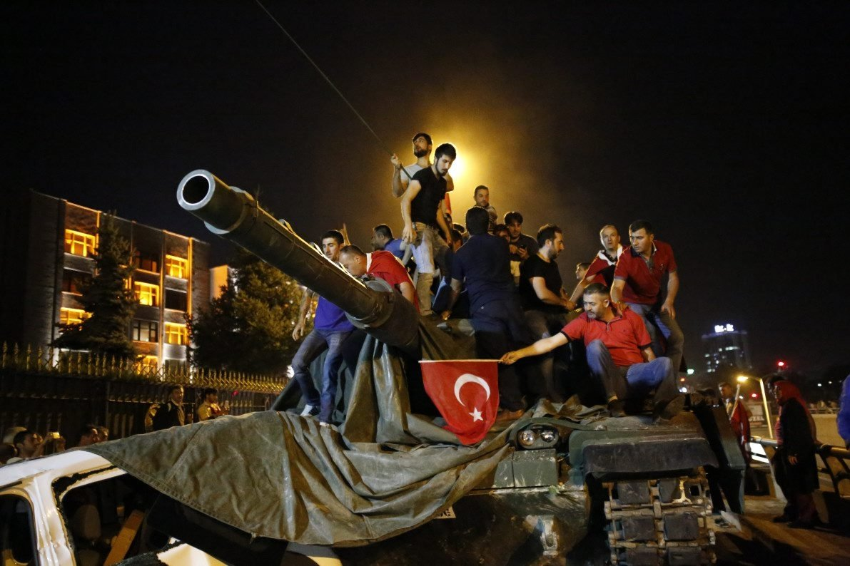 People stand on a tank they seized from the control of FETÖ's putschists, in the capital Ankara, Turkey, July 16, 2016. (REUTERS PHOTO)