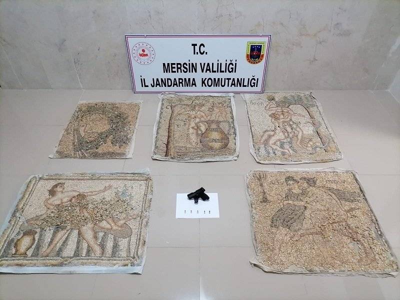 Ancient mosaic paintings seized from a smuggling suspect on display in Mersin, southern Turkey, March 1, 2021. (AA PHOTO)