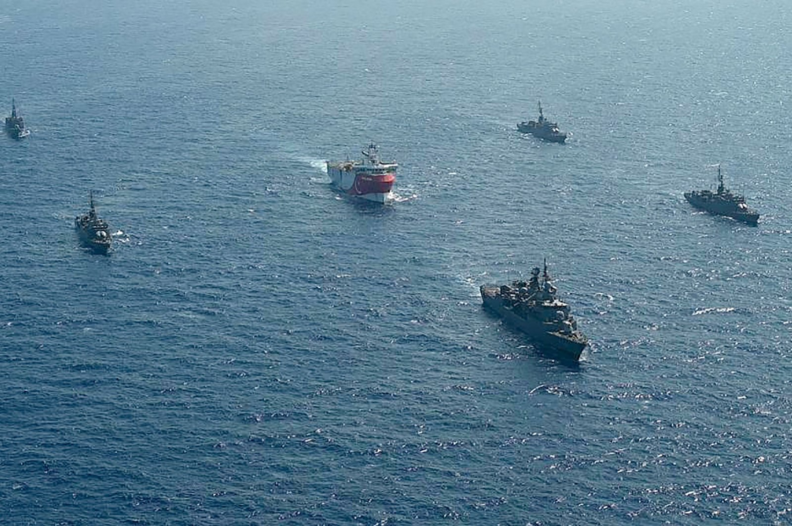 The Turkish seismic research vessel Oruc Reis (C) is escorted by Turkish naval ships in the Mediterranean Sea, off Antalya on Aug. 10, 2020. (AFP Photo)