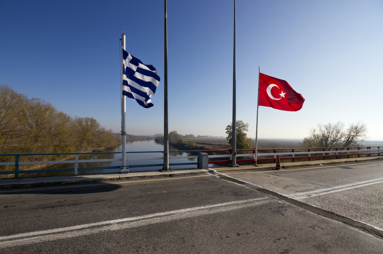 The Greek-Turkish border line right on the bridge over the river Evros. (Shutterstock Photo)