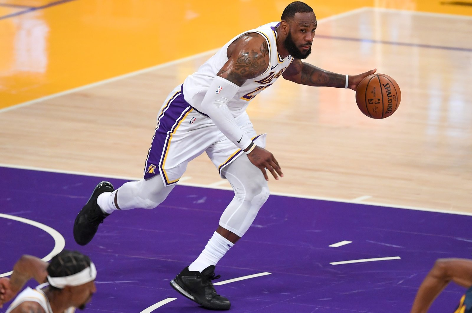 Los Angeles Lakers forward LeBron James (23) takes the ball down court in the second half of the game against the Golden State Warriors at Staples Center, Los Angeles, California, Feb 28, 2021. (Reuters Photo)
