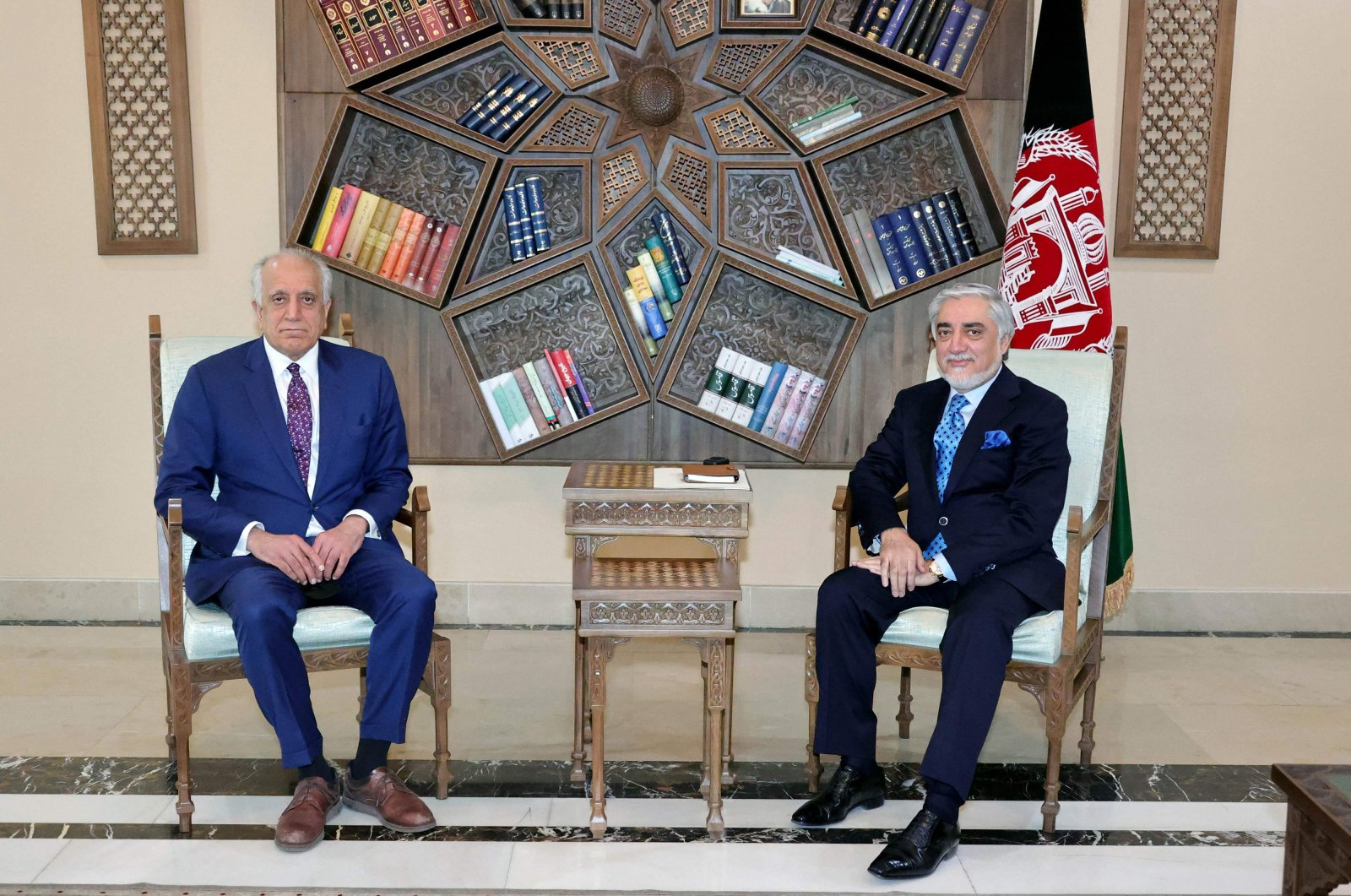 U.S. Special Representative for Afghanistan Reconciliation Zalmay Khalilzad (L) at a meeting with the chairman of Afghanistan's High Council for National Reconciliation, Abdullah Abdullah, at the Sapedar Palace in Kabul, Afghanistan, March 1, 2021. (Press Office of National Reconciliation Council of Afghanistan vie AFP)