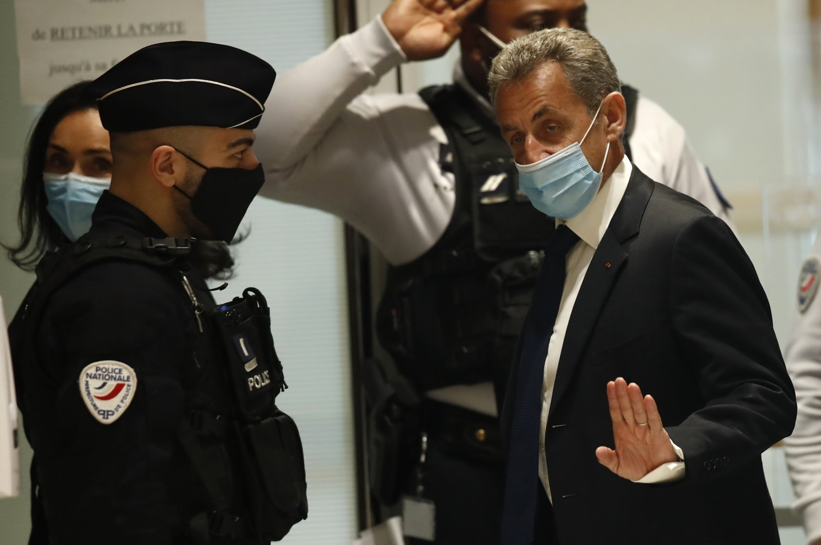 Former French President Nicolas Sarkozy arrives at the courtroom Monday, Paris, France, March 1, 2021. (AP Photo)