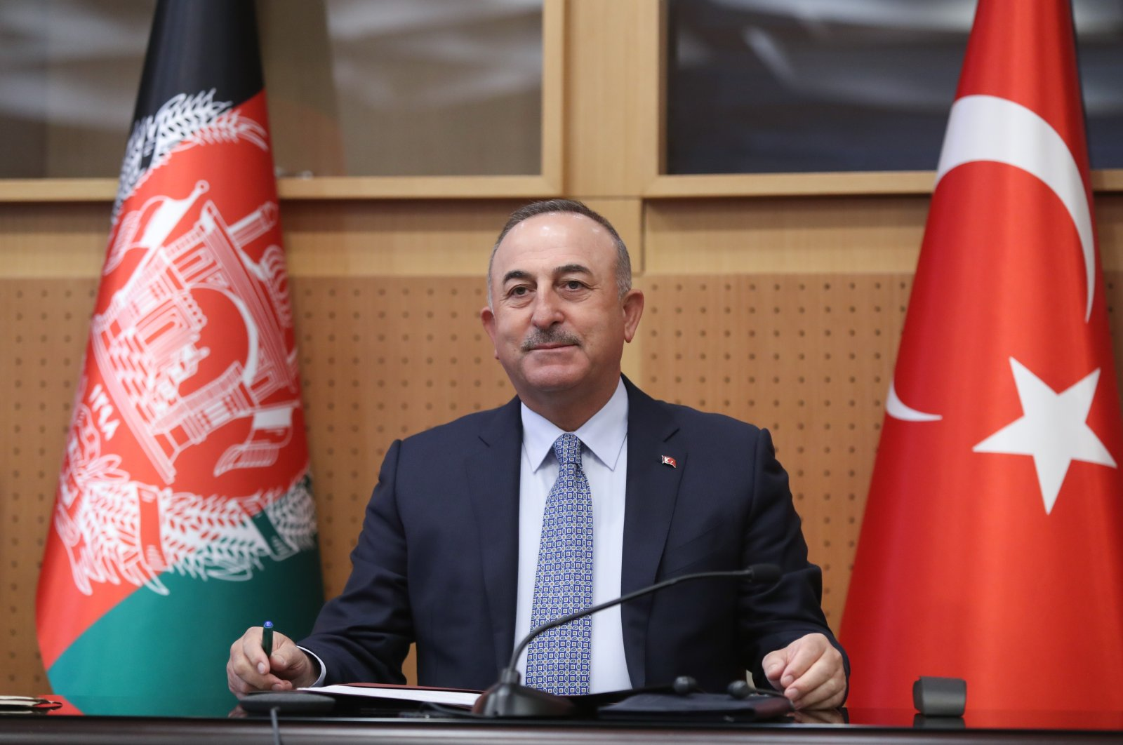 Foreign Minister Mevlüt Çavuşoğlu virtually addresses a ceremony to mark the 100th anniversary of diplomatic relations between the two countries, in the capital Kabul, Afghanistan, March 1, 2021. (AA Photo)