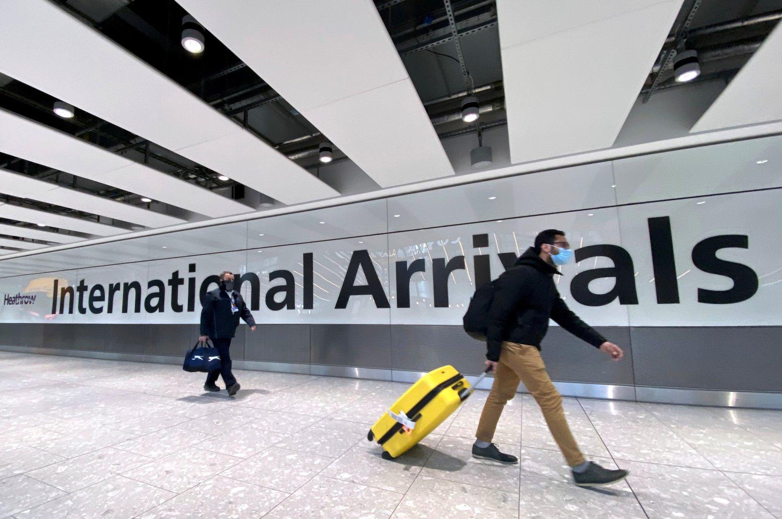 Travelers at Heathrow Airport, London, Britain, Feb. 13, 2021. (Reuters Photo)