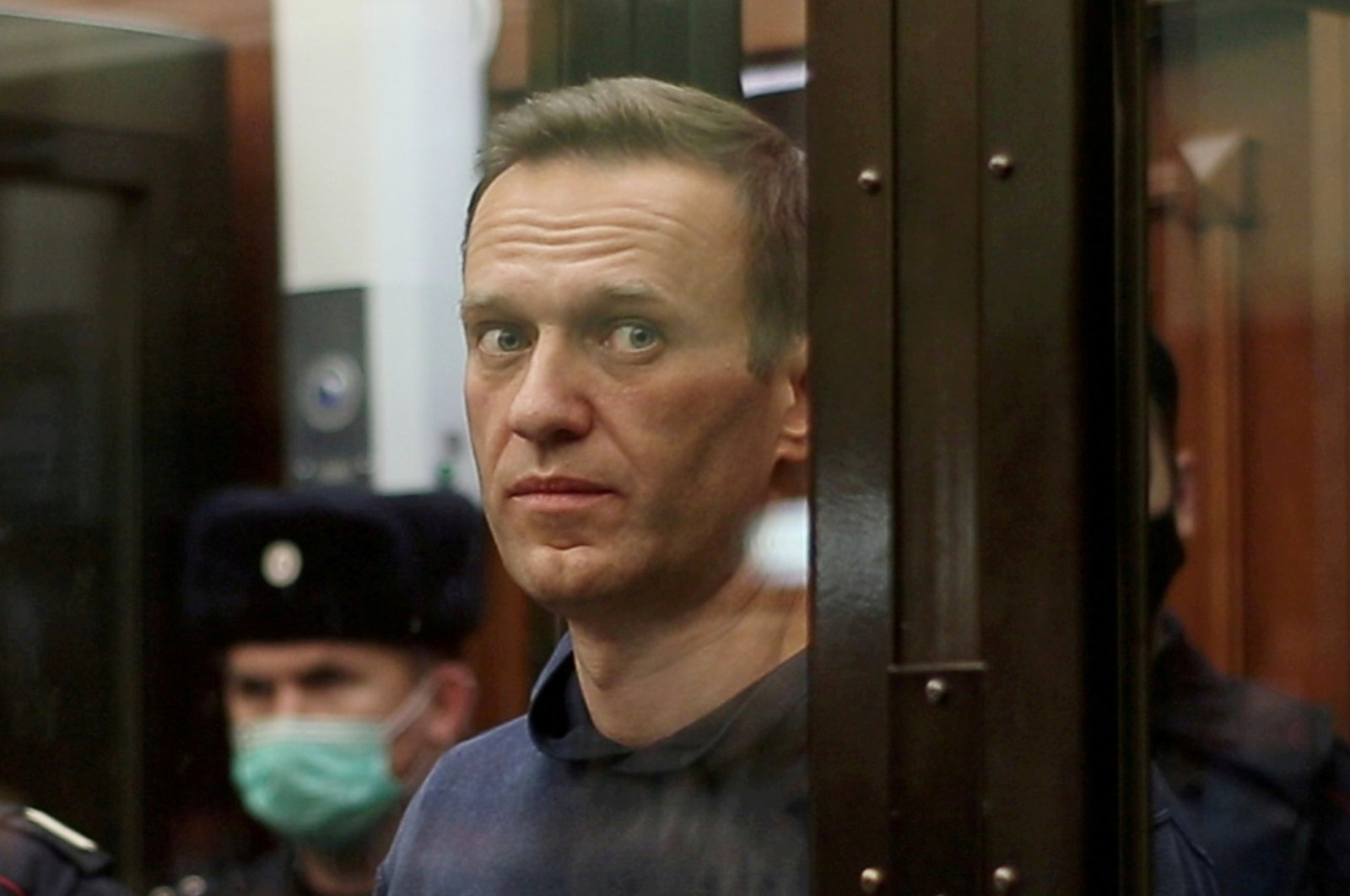 Russian opposition leader Alexei Navalny inside a defendant dock during the announcement of a court verdict in Moscow, Russia, Feb. 2, 2021. (Reuters Photo)