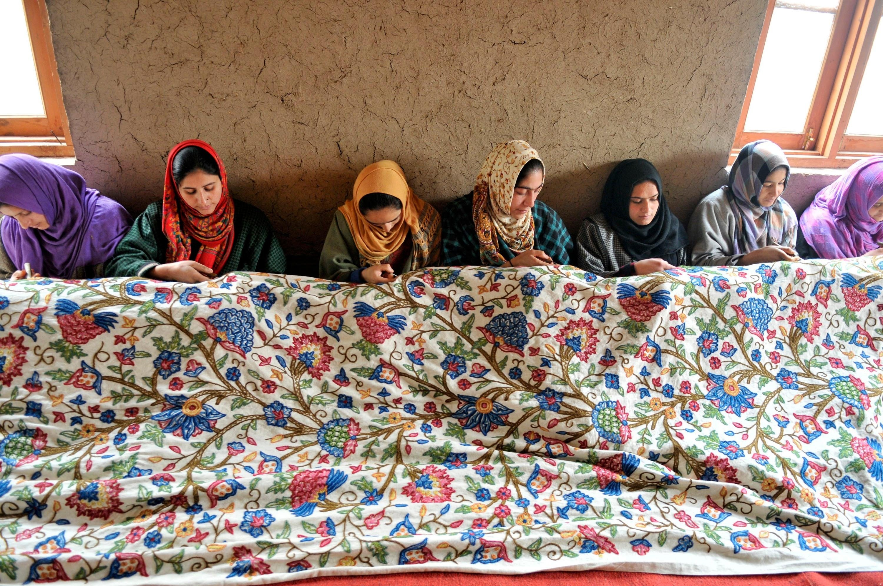 Kashmiri women do intricate embroidery on window curtains at a state-run center on Dec. 9, 2015. (Getty Images)
