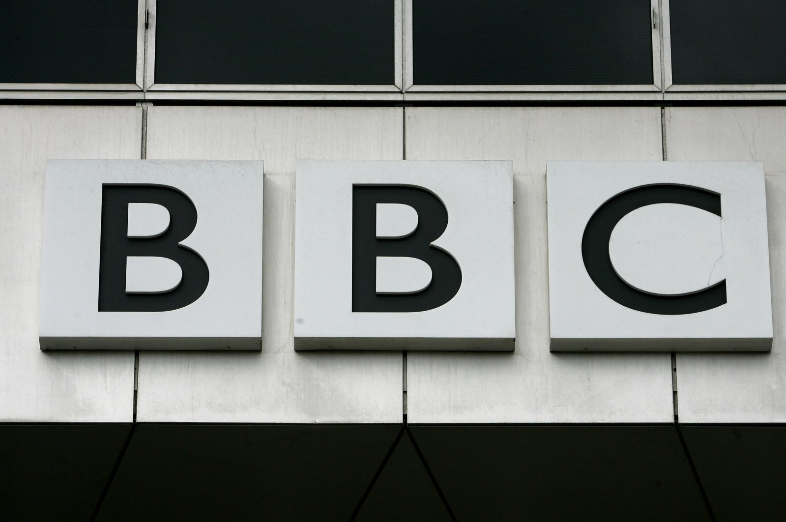 The British Broadcasting Corporation (BBC) sign can be seen on their offices at White City in London, Oct. 17, 2007. (AP Photo)
