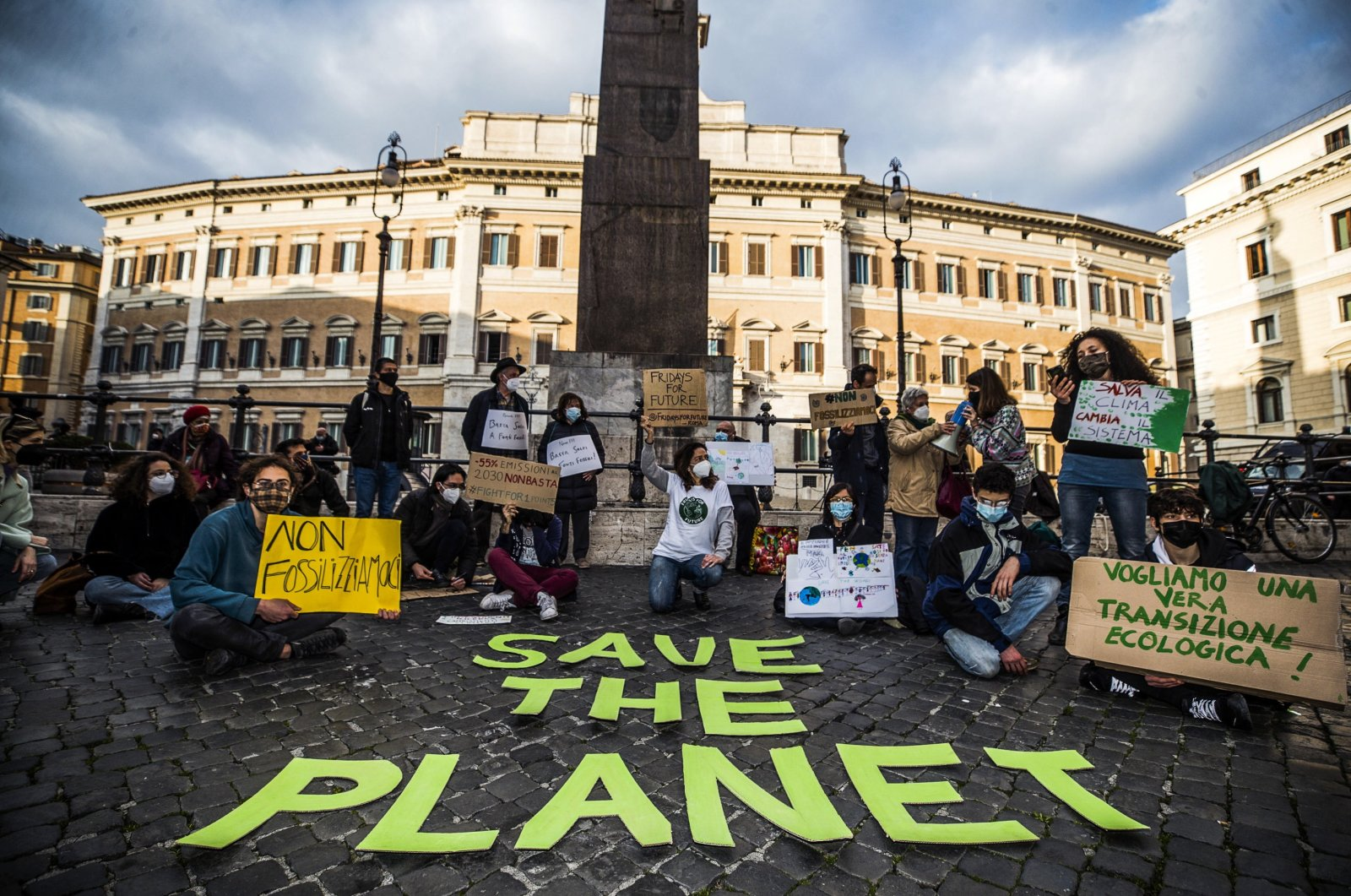 Protesters carry placards at the Fridays for Future Italia initiative in Montecitorio square in Rome, Italy, Feb. 19, 2021. (EPA)