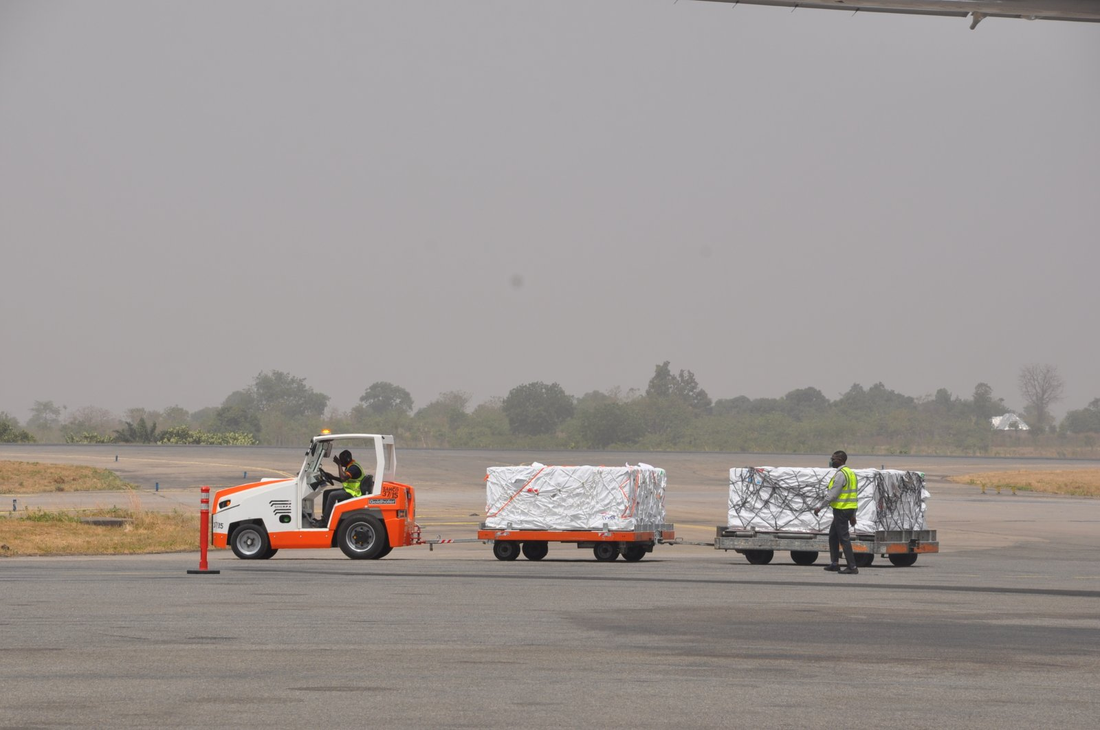COVID-19 vaccines are offloaded from a plane at Lagos airport, Tuesday March 2, 2021. (AP Photo)