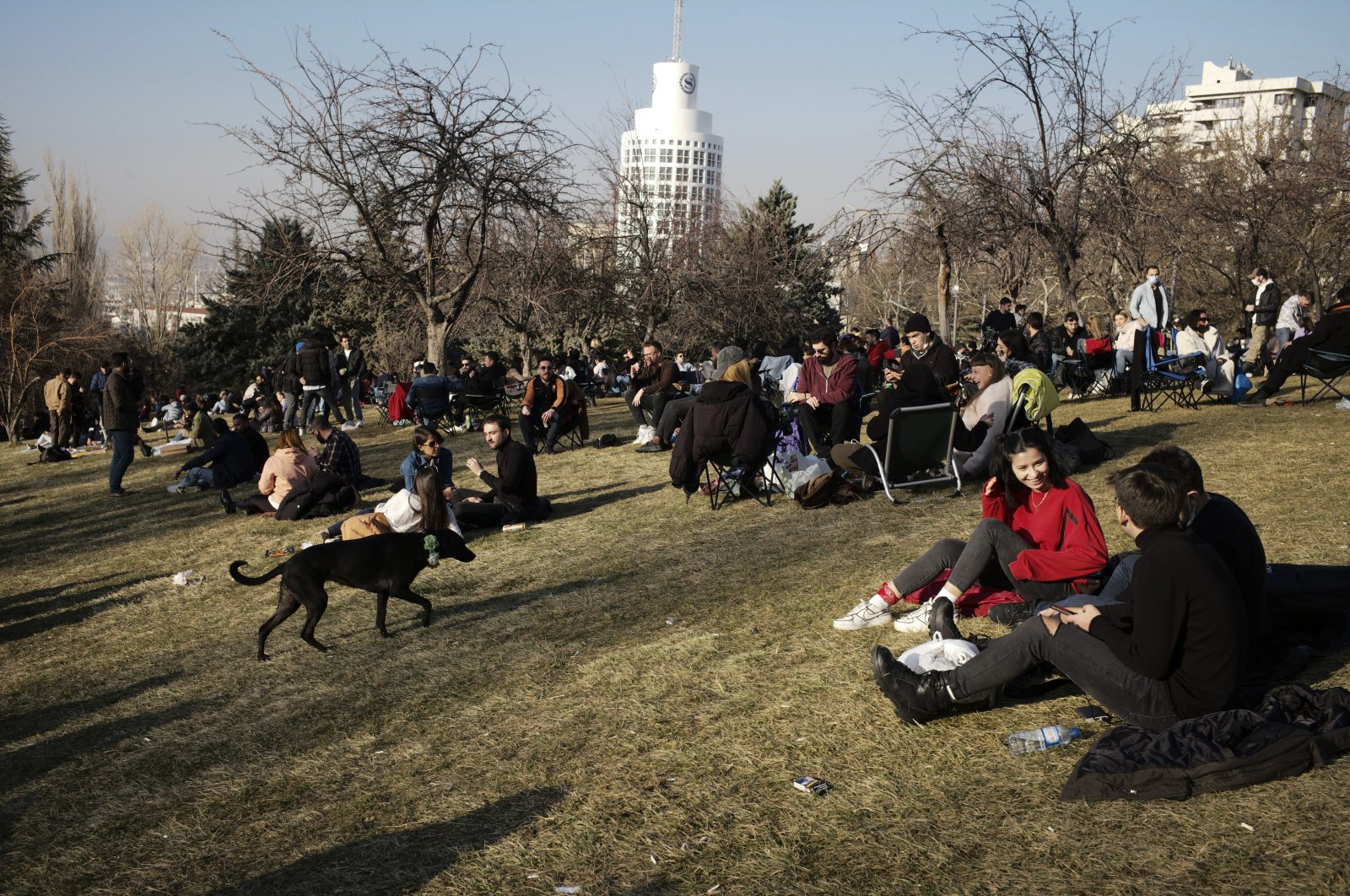 People enjoy the good weather in a park hours before a two-day weekend curfew, in Ankara, Turkey, Friday, Feb. 26, 2021. (AP Photo)