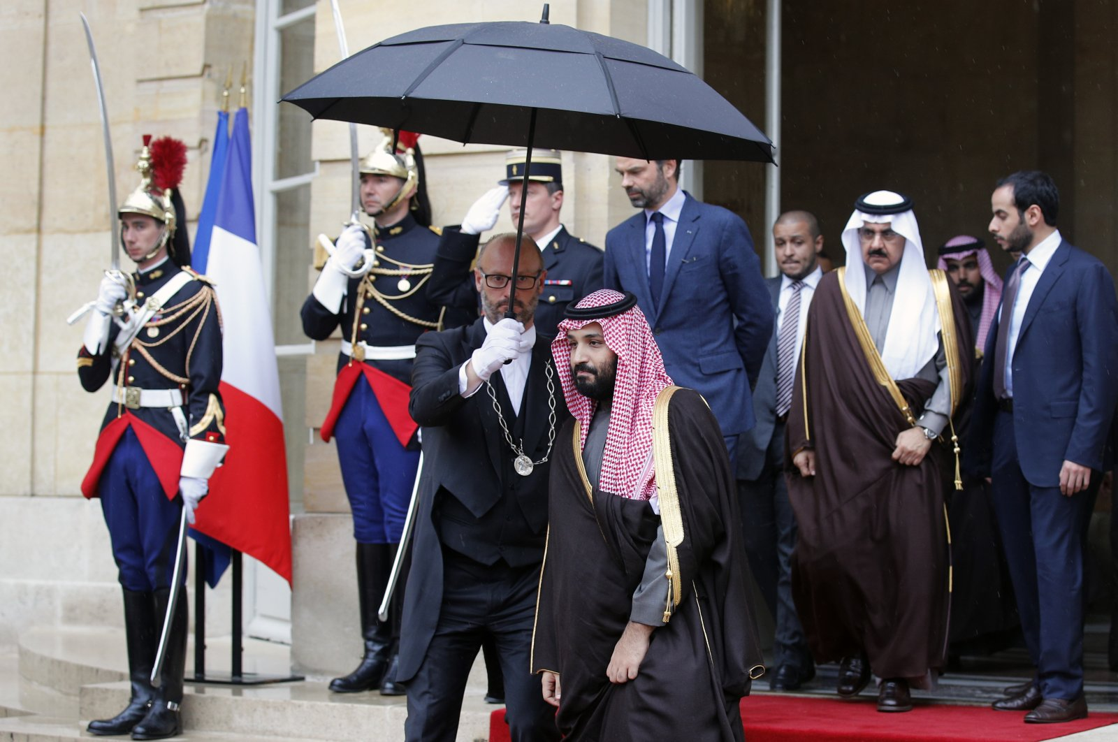 Saudi Arabia's Crown Prince M. bin Salman, center, walks out after his meeting with then-French Prime Minister Edouard Philippe, center back, in Paris, Monday April 9, 2018. (AP File Photo)